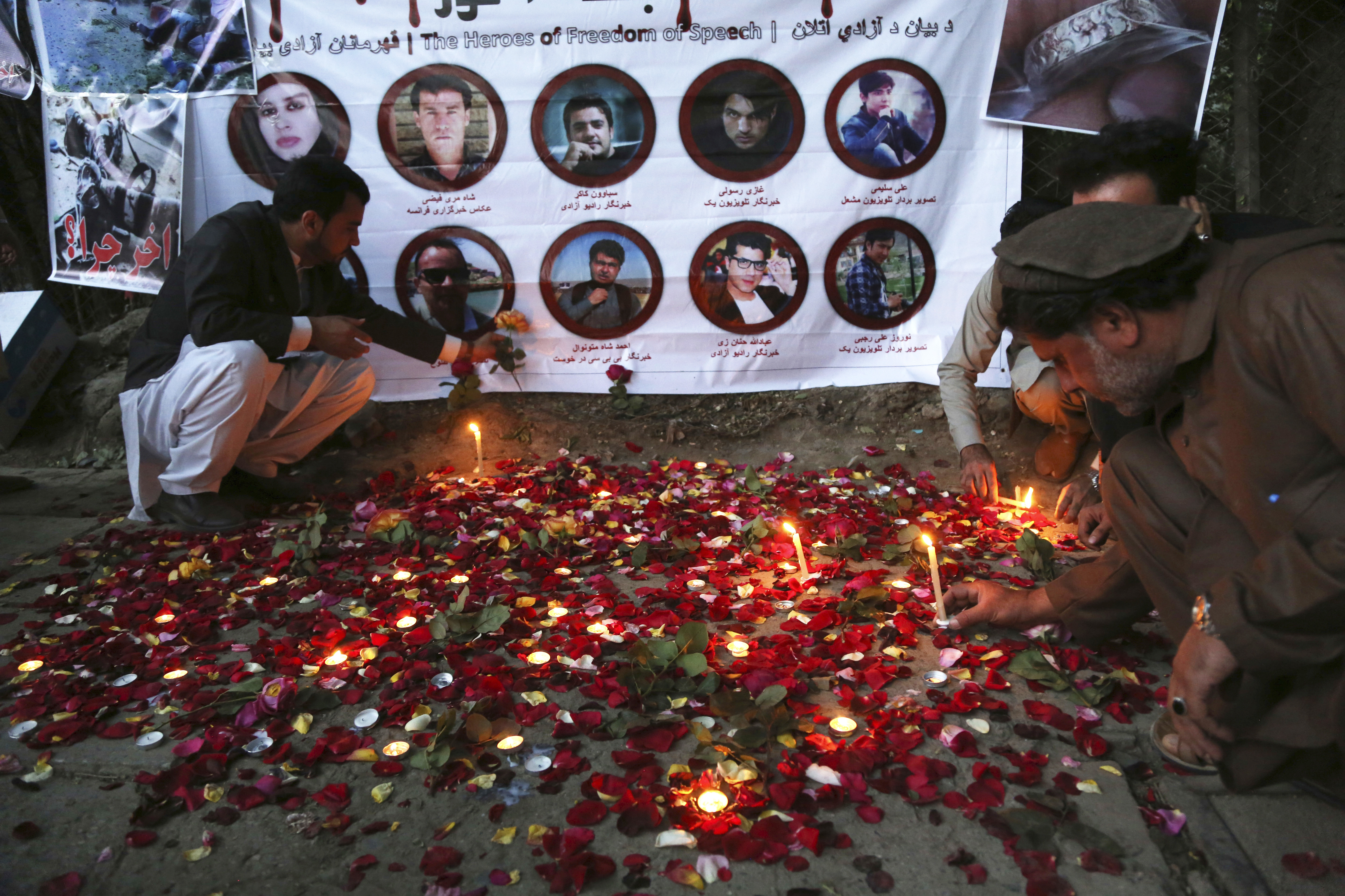 Afghan residents light candles to pay tribute to Afghan journalists killed in a suicide attack in Kabul, Afghanistan, May 3, 2018.  Two Islamic State suicide bombers struck in Afghanistan's capital, killing 25 people, including nine journalists who h...