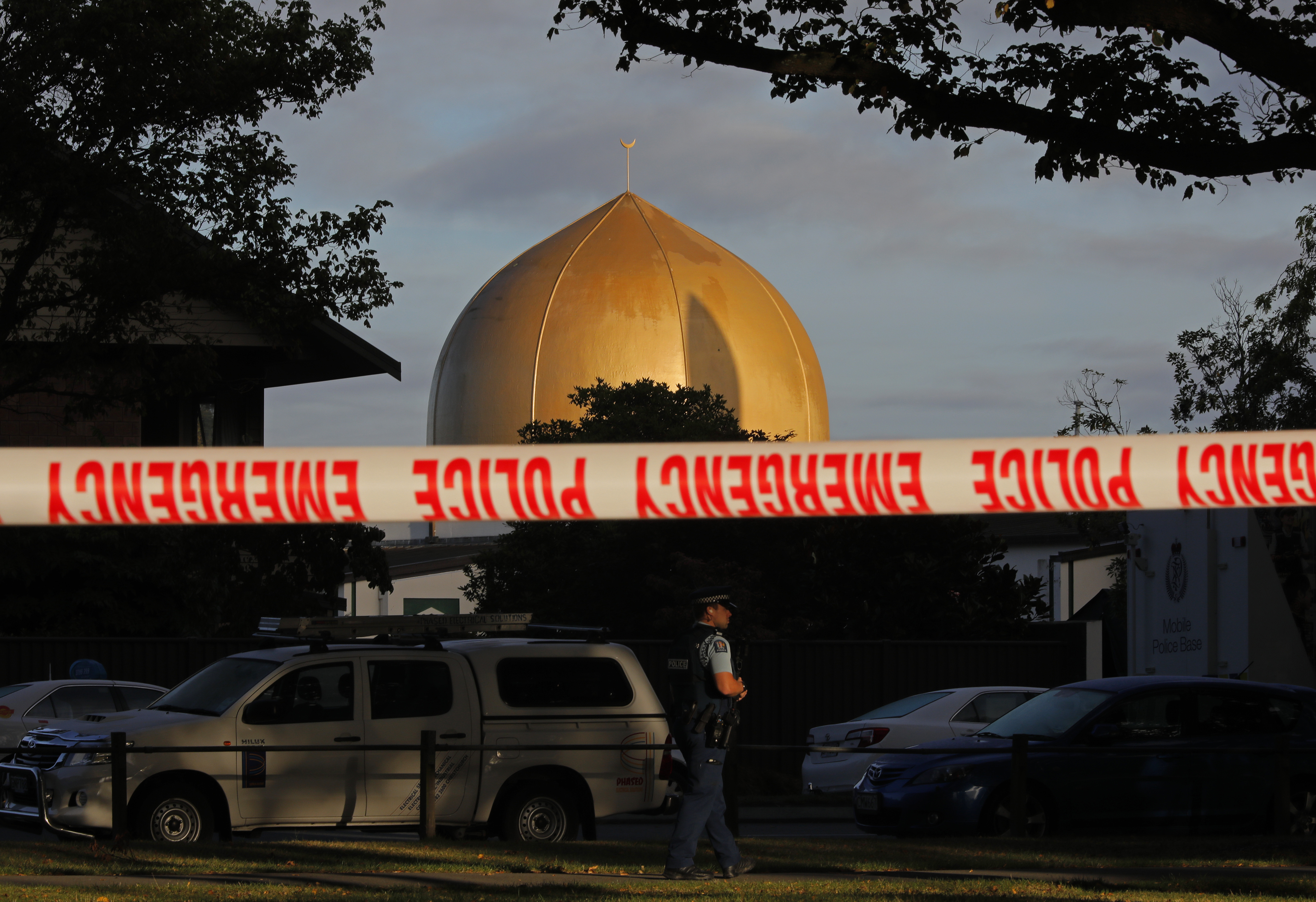 A police officer stands guard in front of the Al Noor Mosque in Christchurch, New Zealand, March 17, 2019, where one of the two mass shootings occurred. New Zealand's stricken residents reached out to Muslims in their neighborhoods and around the cou