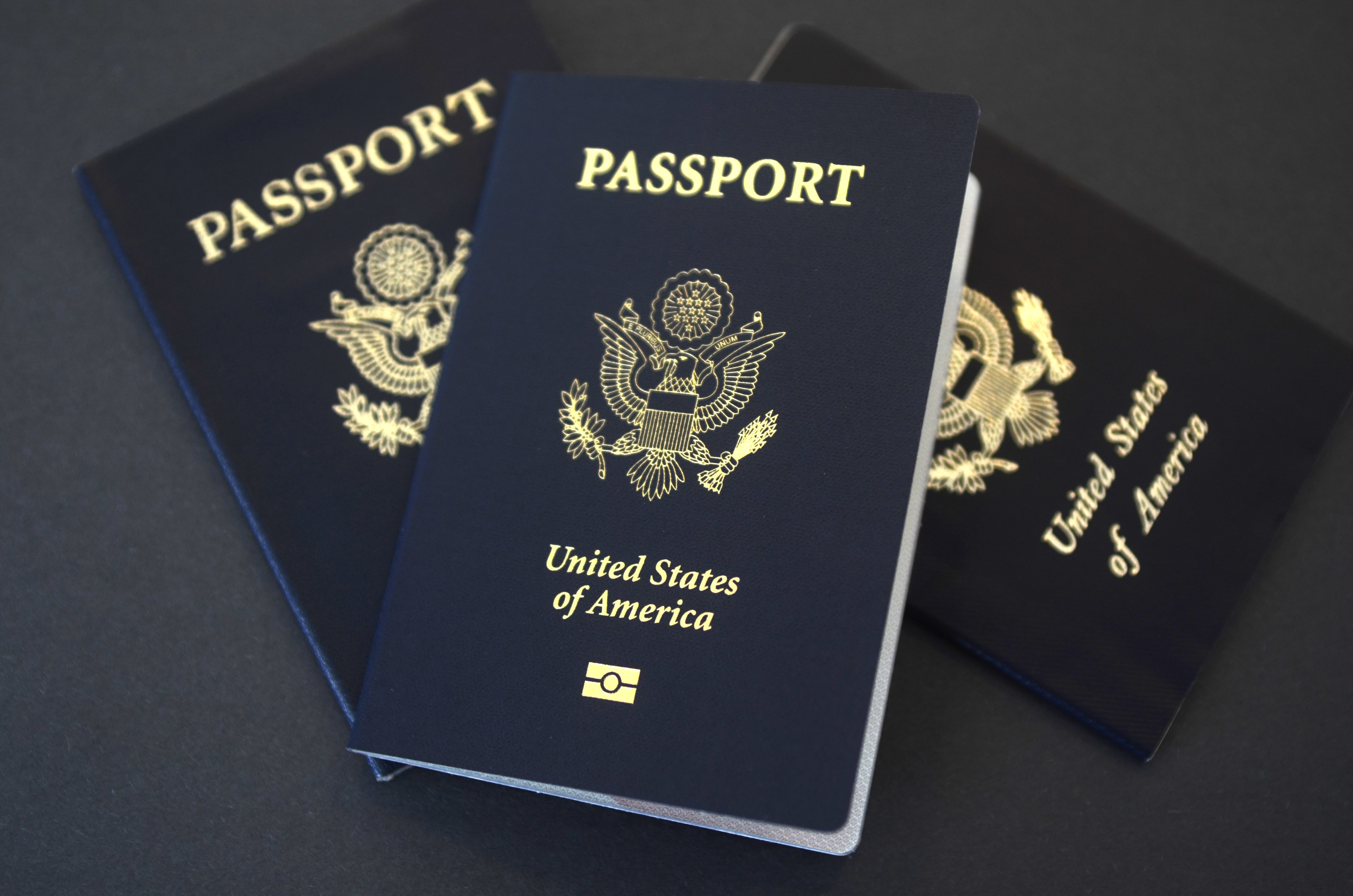 In this May 9, 2017 photo, U.S. passports lie on a table in Dallas, Texas. The U.S. State Department is in the middle of a record year for processing passport applications, with 20.5 million renewals and applications for new passports expected.