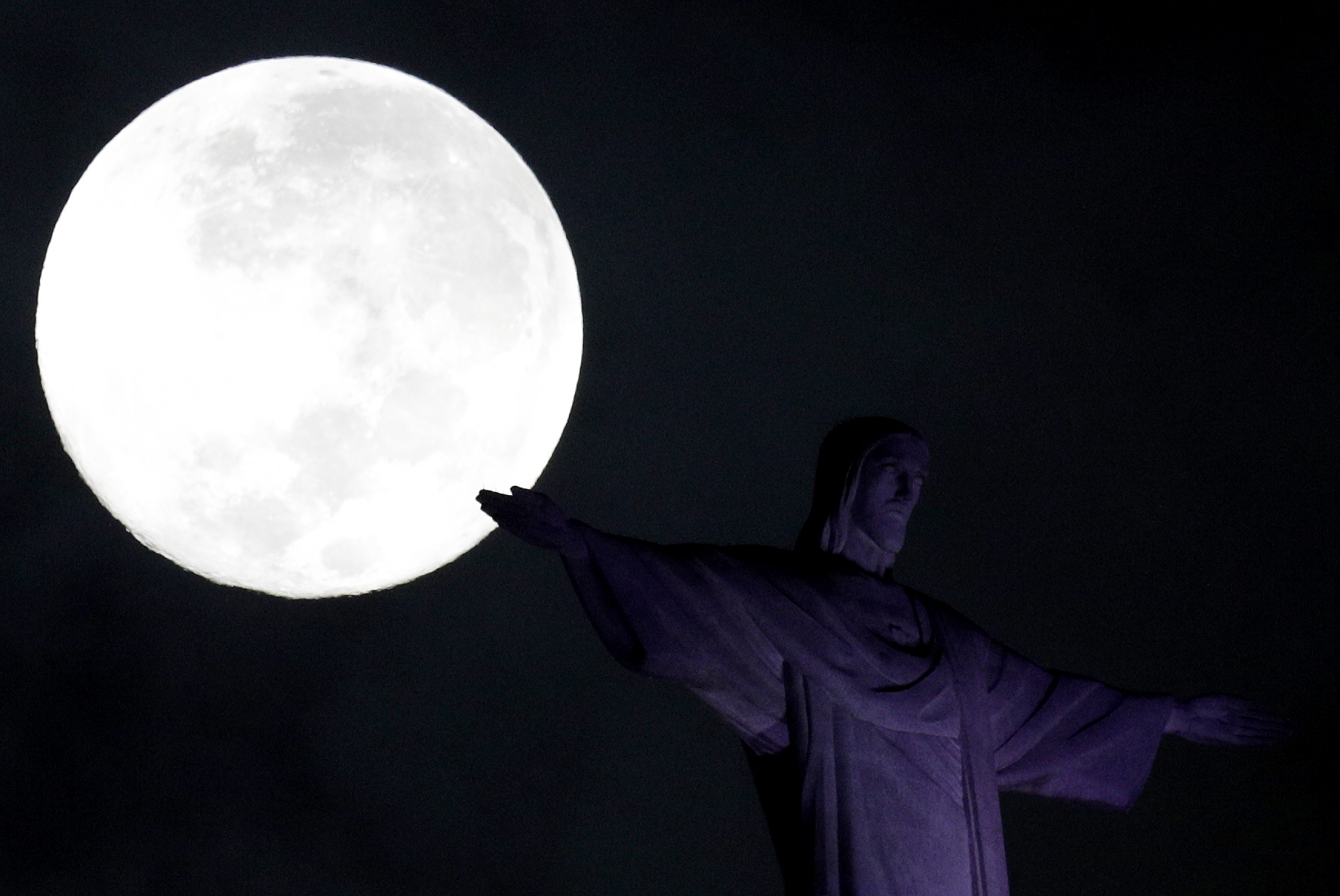 A full moon 'supermoon' is pictured next to the statue of Christ the Redeemer in Rio de Janeiro, Brazil, Feb. 1, 2018.