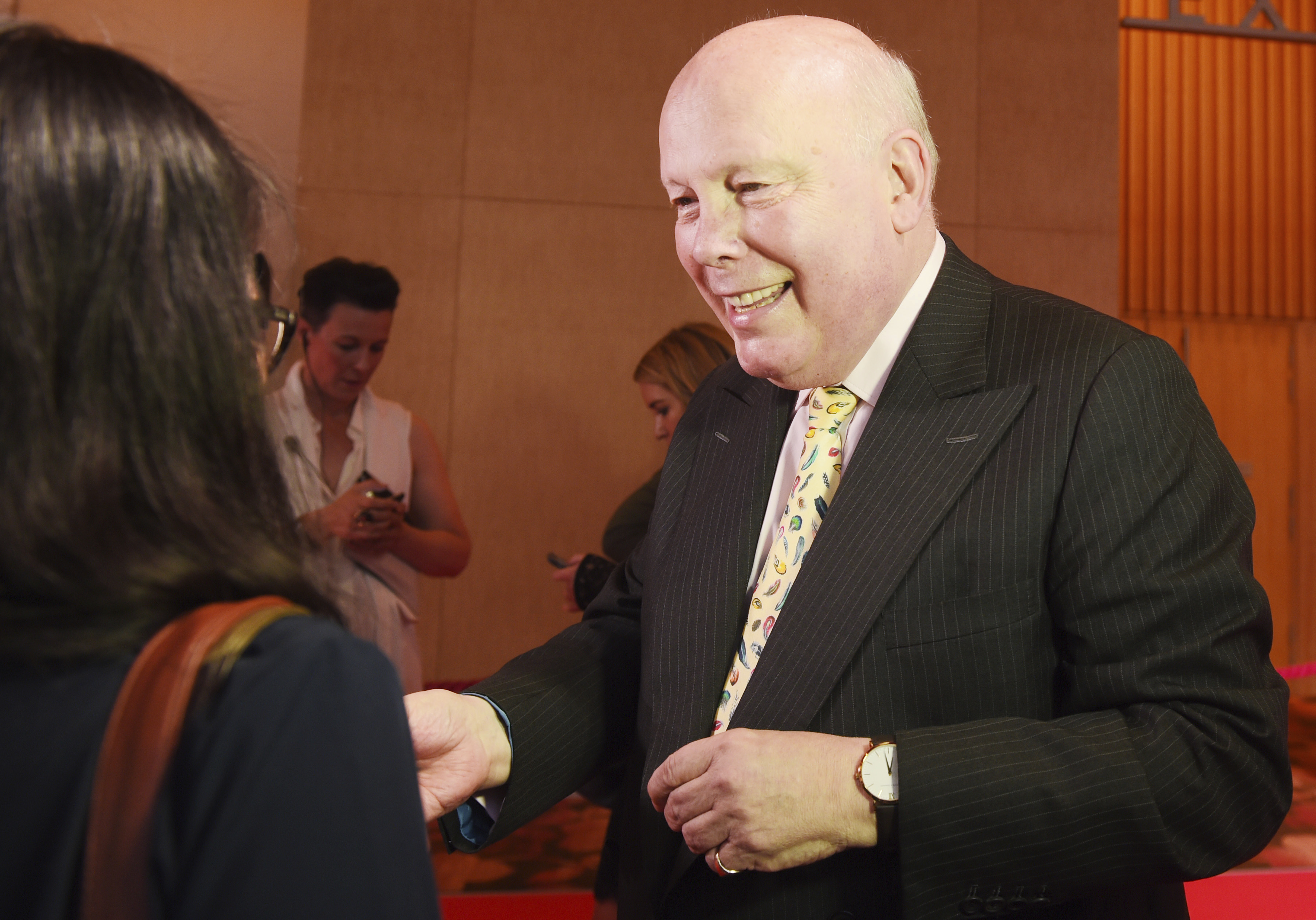 FILE - Julian Fellowes, writer of television series Downtown Abbey greets fans on the red carpet at the launch of an exhibition about the television series at the Marina Bay Sands on June 21, 2017, in Singapore.