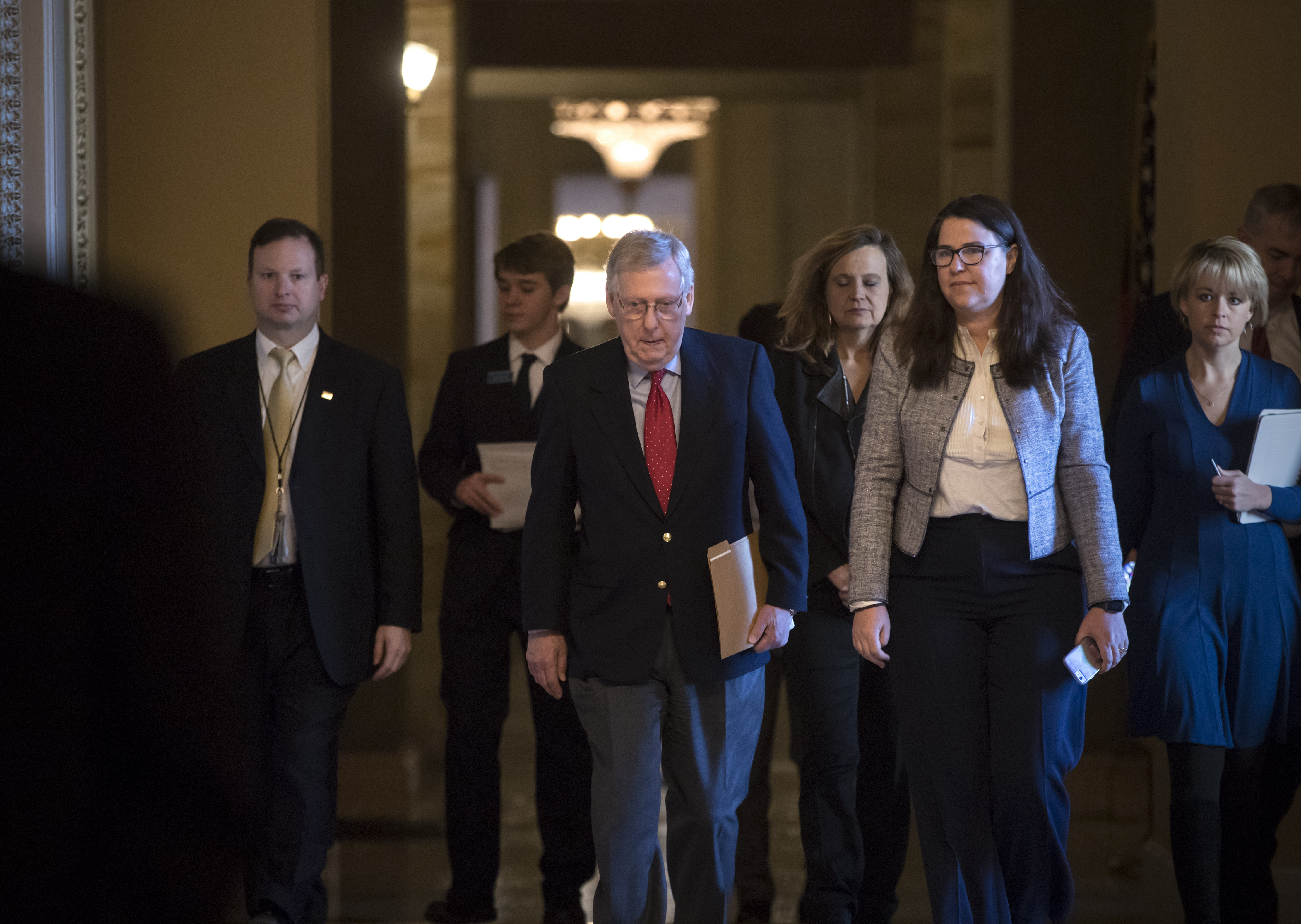 Senate Majority Leader Mitch McConnell, R-Kentucky, walks to the chamber on the first morning of a government shutdown after a divided Senate rejected a funding measure last night, at the Capitol in Washington, Jan. 20, 2018.