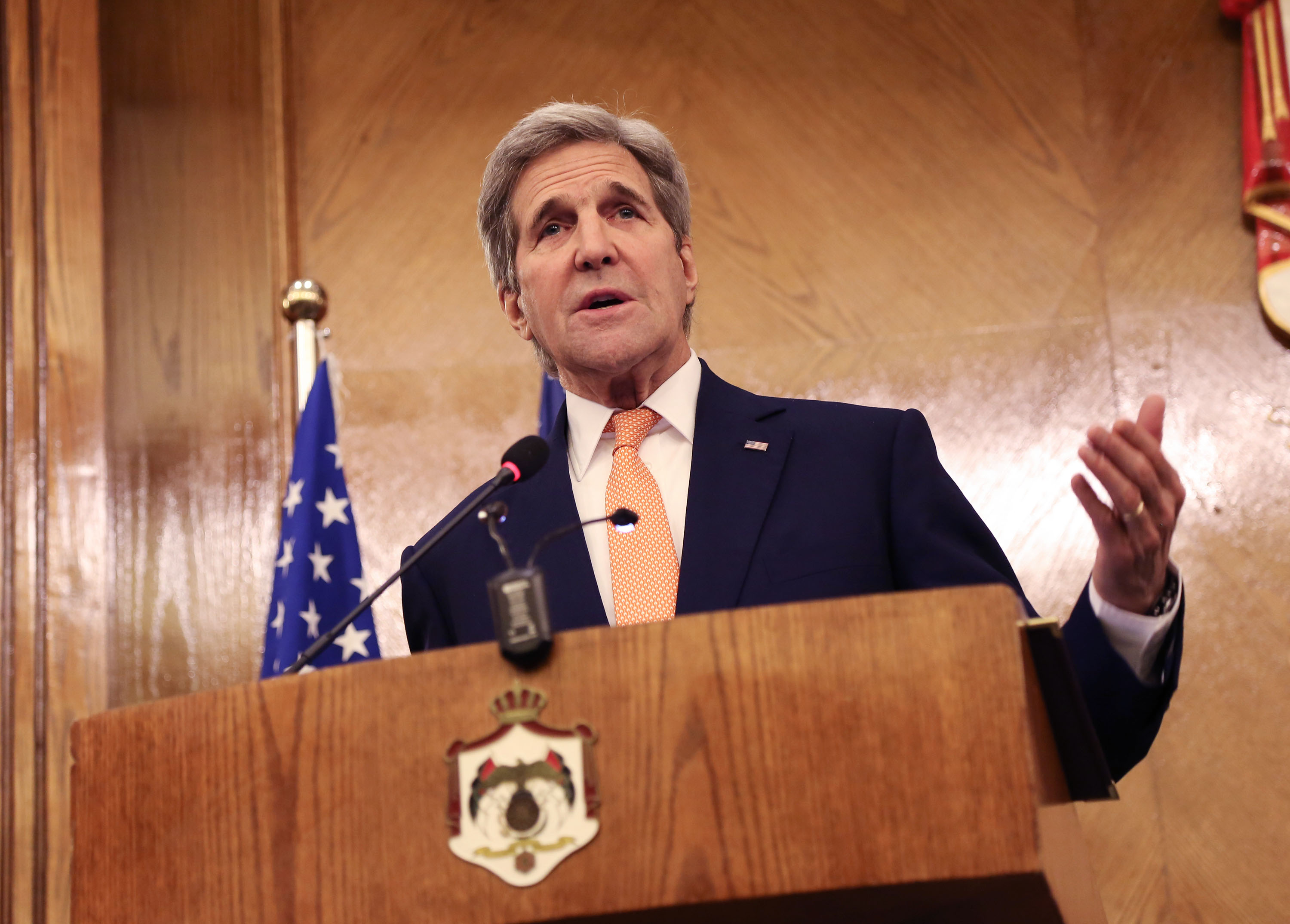 Secretary of State John Kerry gestures during a joint press conference with his Jordanian counterpart Nasser Judeh (unseen) in Amman, Jordan, Feb. 21, 2016.