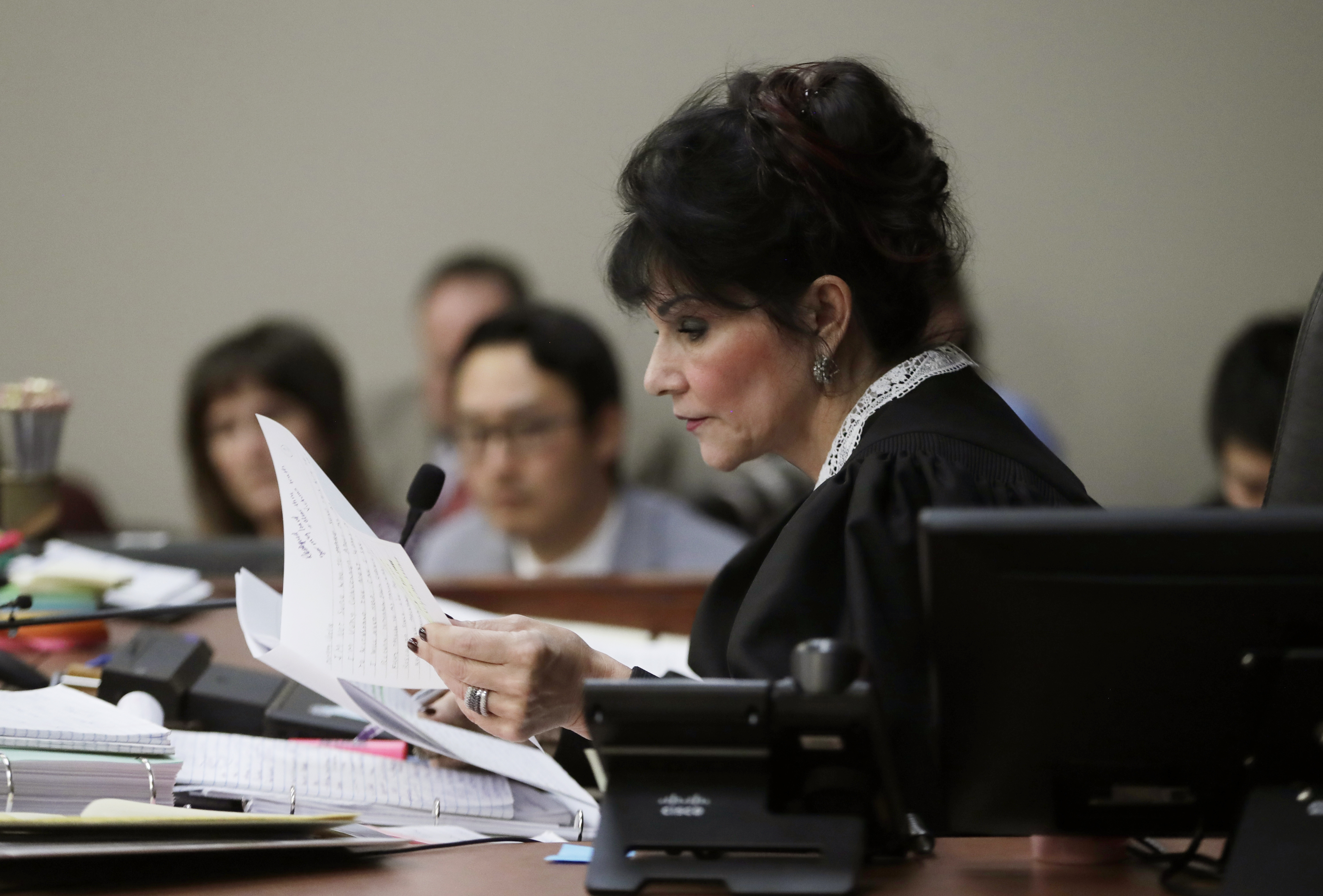 Judge Rosemarie Aquilina reads excerpts from the letter written by Larry Nassar during the seventh day of Nassar's sentencing hearing, Jan. 24, 2018, in Lansing, Mich. The former sports doctor who admitted molesting some of the nation's top gymnasts