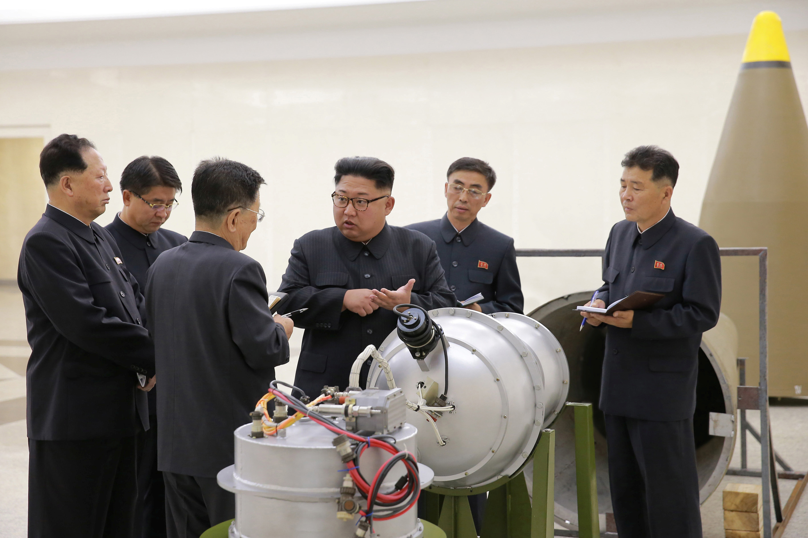 North Korean leader Kim Jong Un, center, provides guidance on a nuclear weapons development in this undated photo released by North Korea's Korean Central News Agency in Pyongyang, Sept. 3, 2017.