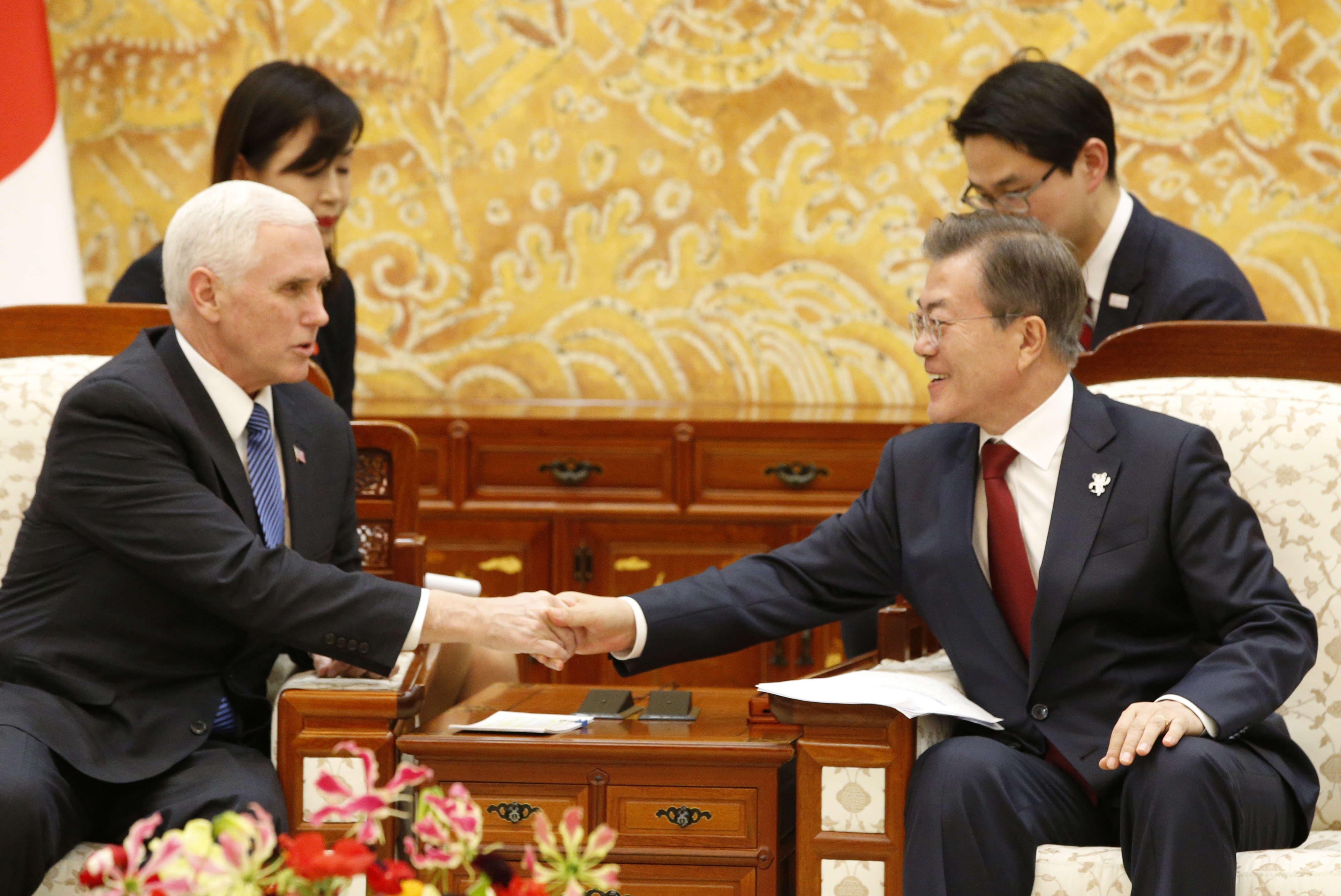 U.S. Vice President Mike Pence shakes hands with South Korean President Moon Jae-in after their meeting at the presidential office in Seoul, South Korea, Feb. 8, 2018.