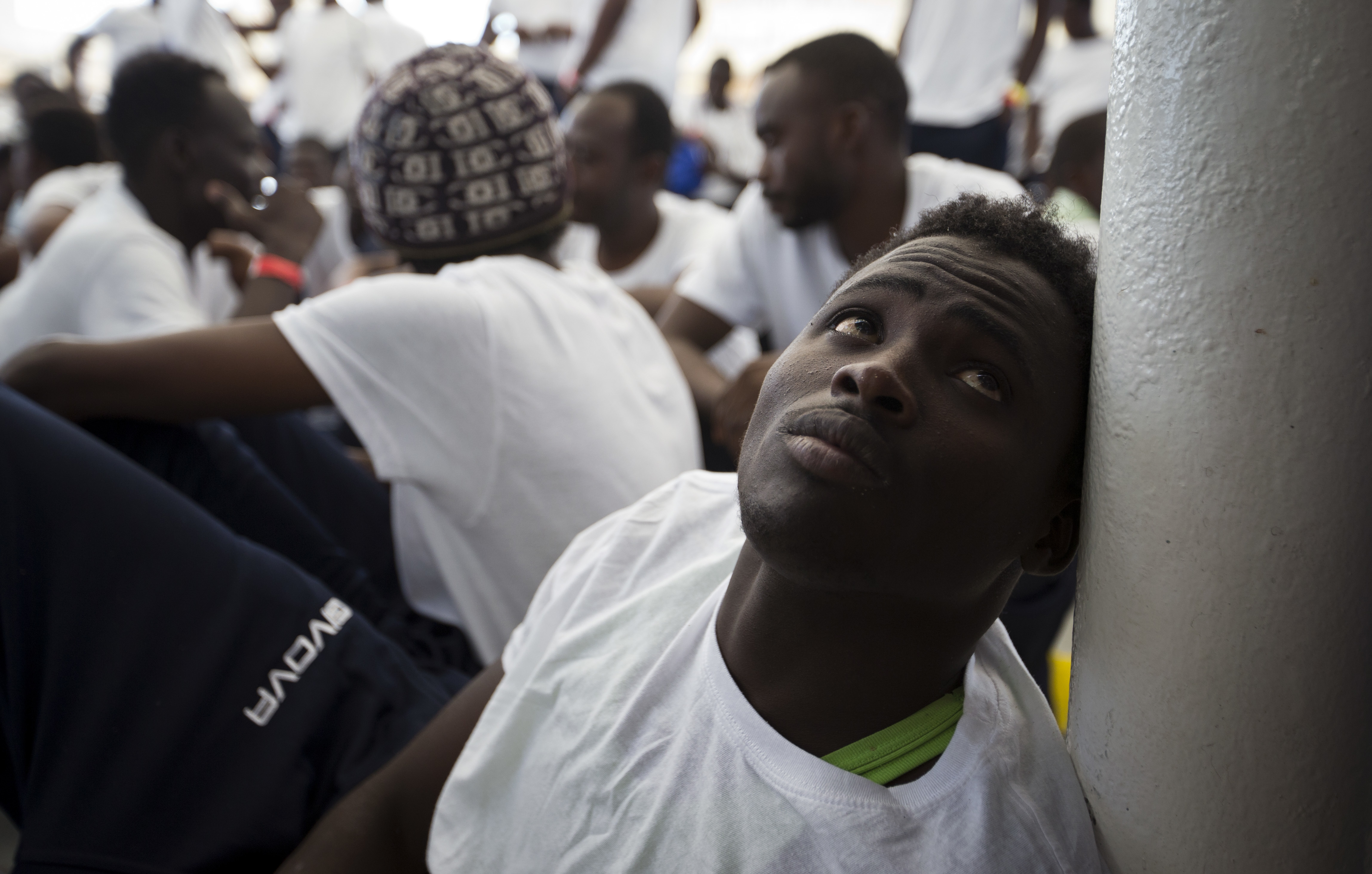 FILE-An African migrant rests after being rescued in a rescue operation, on the Aquarius vessel of SOS Mediterranee NGO and MSF (Doctors Without Borders) in the international waters some 25 Nautical miles (29 miles, 46 kilometers) north of the Libyan...