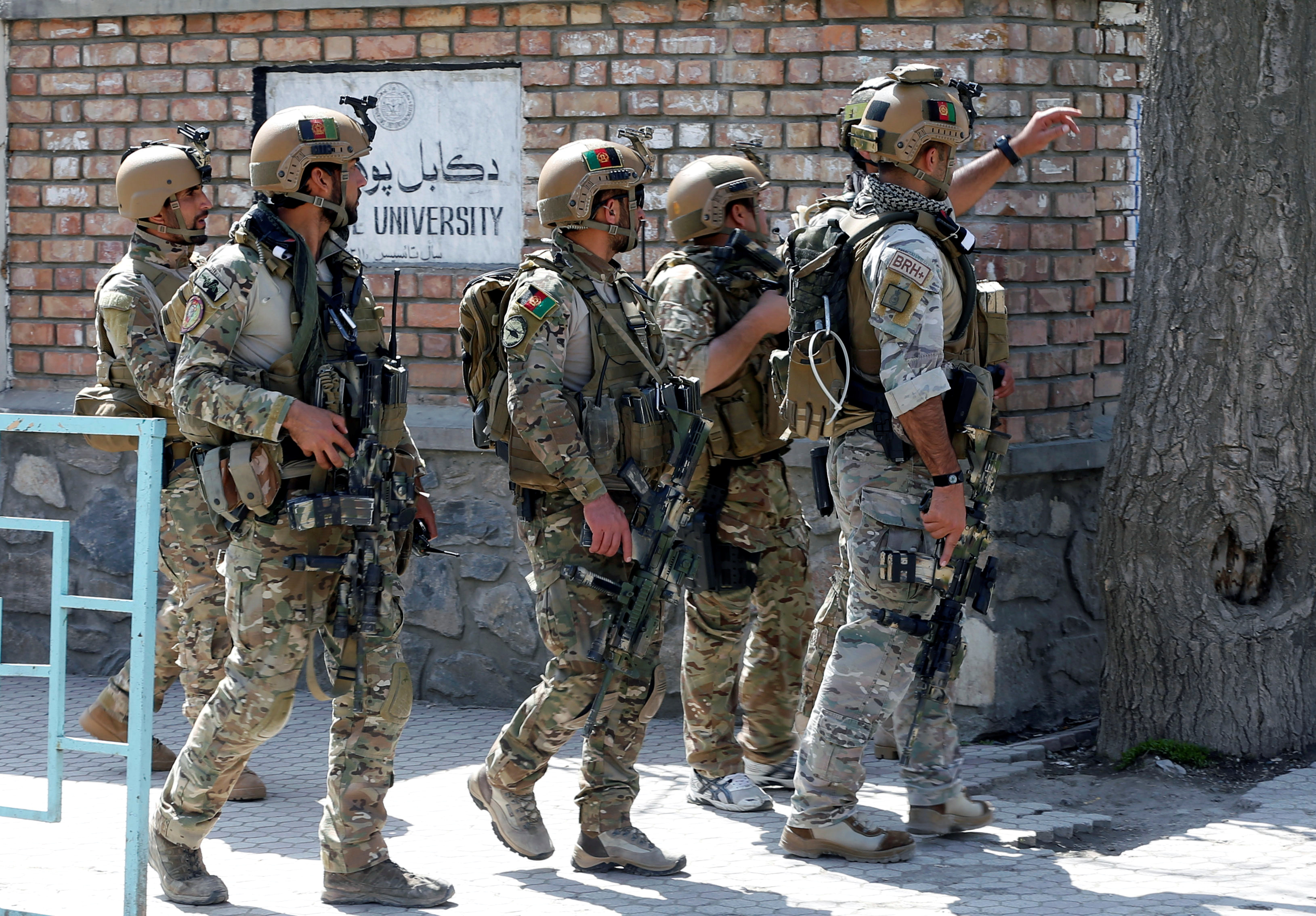 FILE - Afghan security forces arrive at the site of a suicide attack in Kabul, Afghanistan, March 21, 2018.