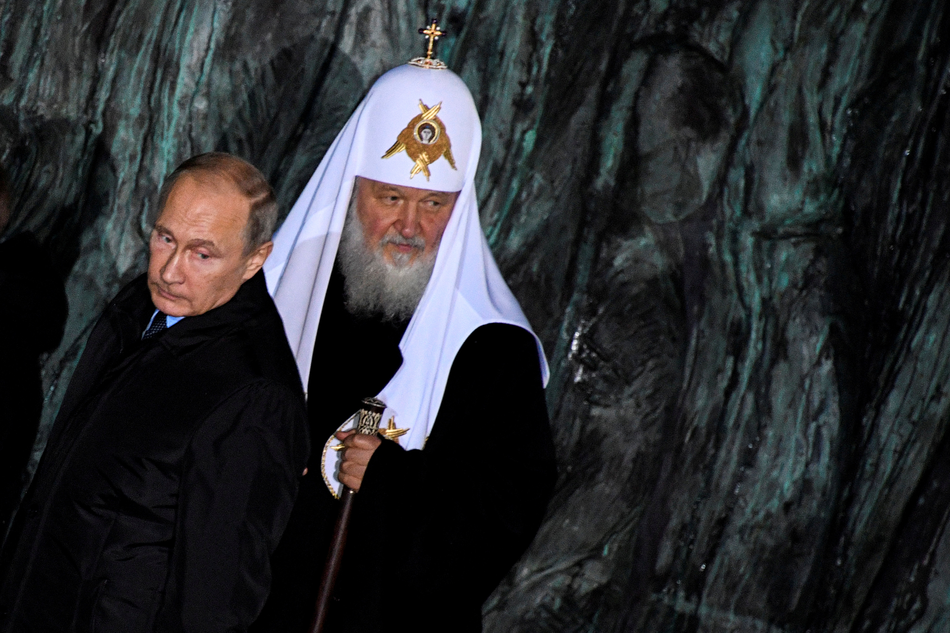 "FILE - Russian President Vladimir Putin and Patriarch Kirill, the head of the Russian Orthodox Church, attend a ceremony unveiling the country's first national memorial to victims of Soviet-era political repressions called ""The Wall of Grief"" in Mosc..."