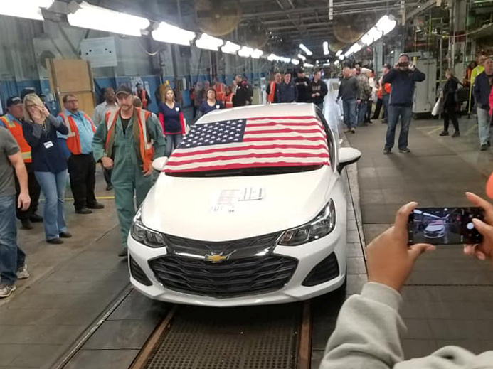 FILE - Employees watch as the last Chevrolet Cruze rolls off the assembly line at the General Motors Co assembly plant in Lordstown, Ohio, March 6, 2019, in this photo obtained from social media.