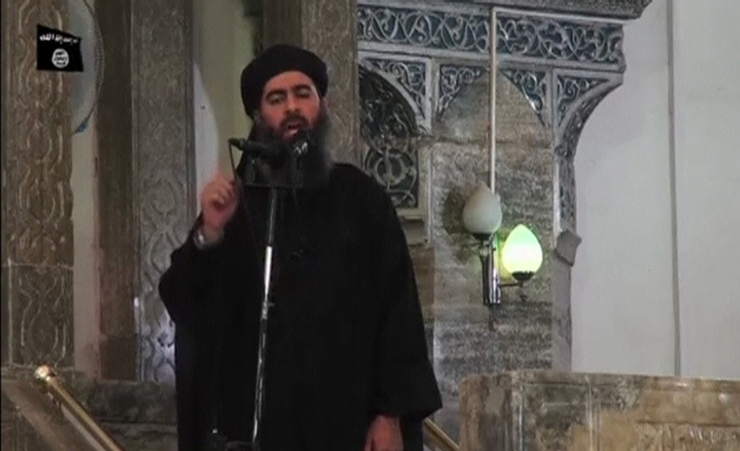 Smage taken from recently released video shows man purported to be Abu Bakr al-Baghdadi, ISIL's reclusive leader, making what would be his first public appearance at a mosque in the centre of Iraq's second city, Mosul July 5, 2014.