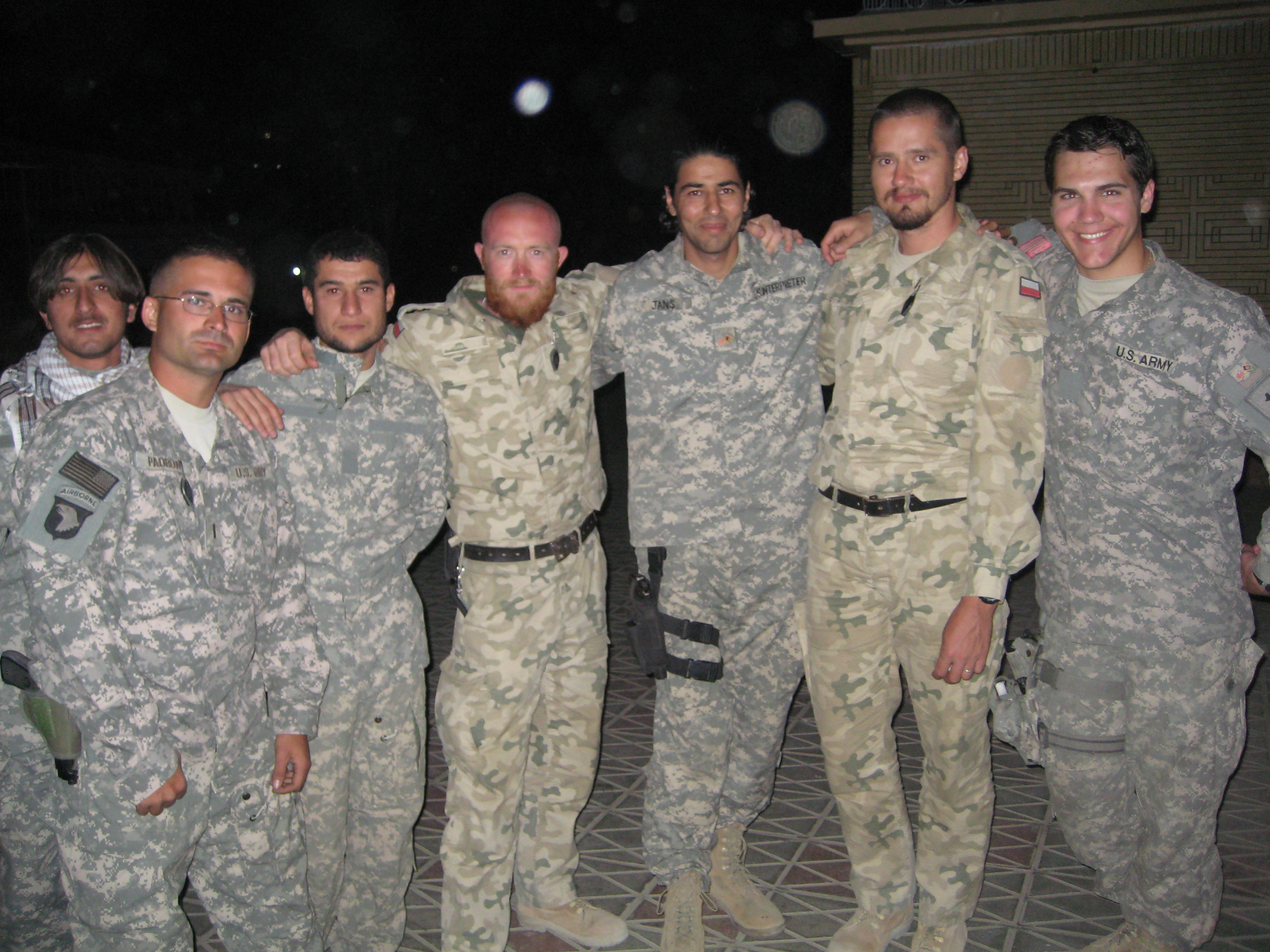 Janis Shinwari (third from right), an Afghan special immigrant visa recipient and co-founder of No One Left Behind, served as a translator for the U.S. military.