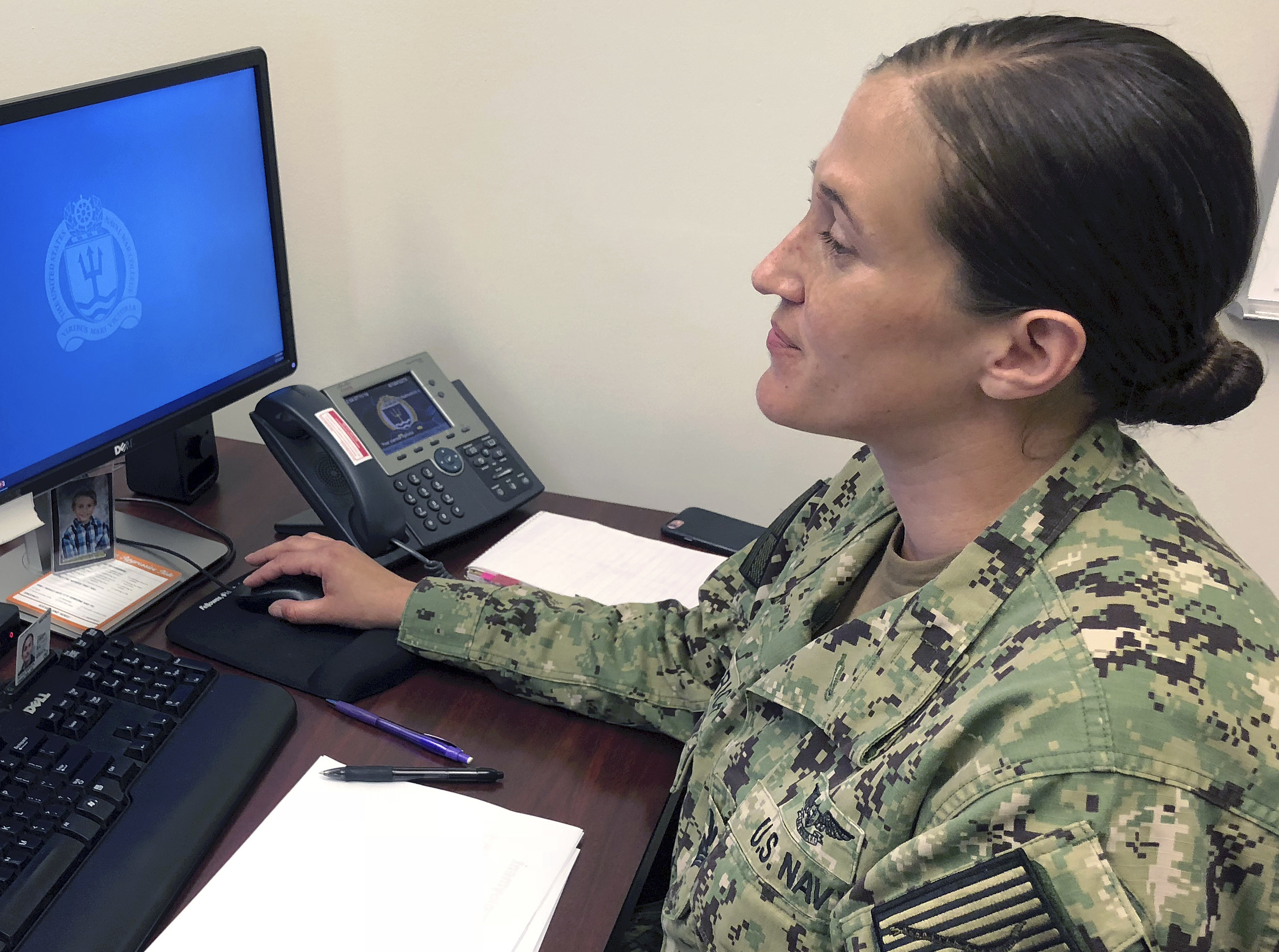 U.S. Navy Legalman First Class Tamatha Schulmerich works at her desk at the Naval War College, July 11, 2018, in Newport, R.I.
