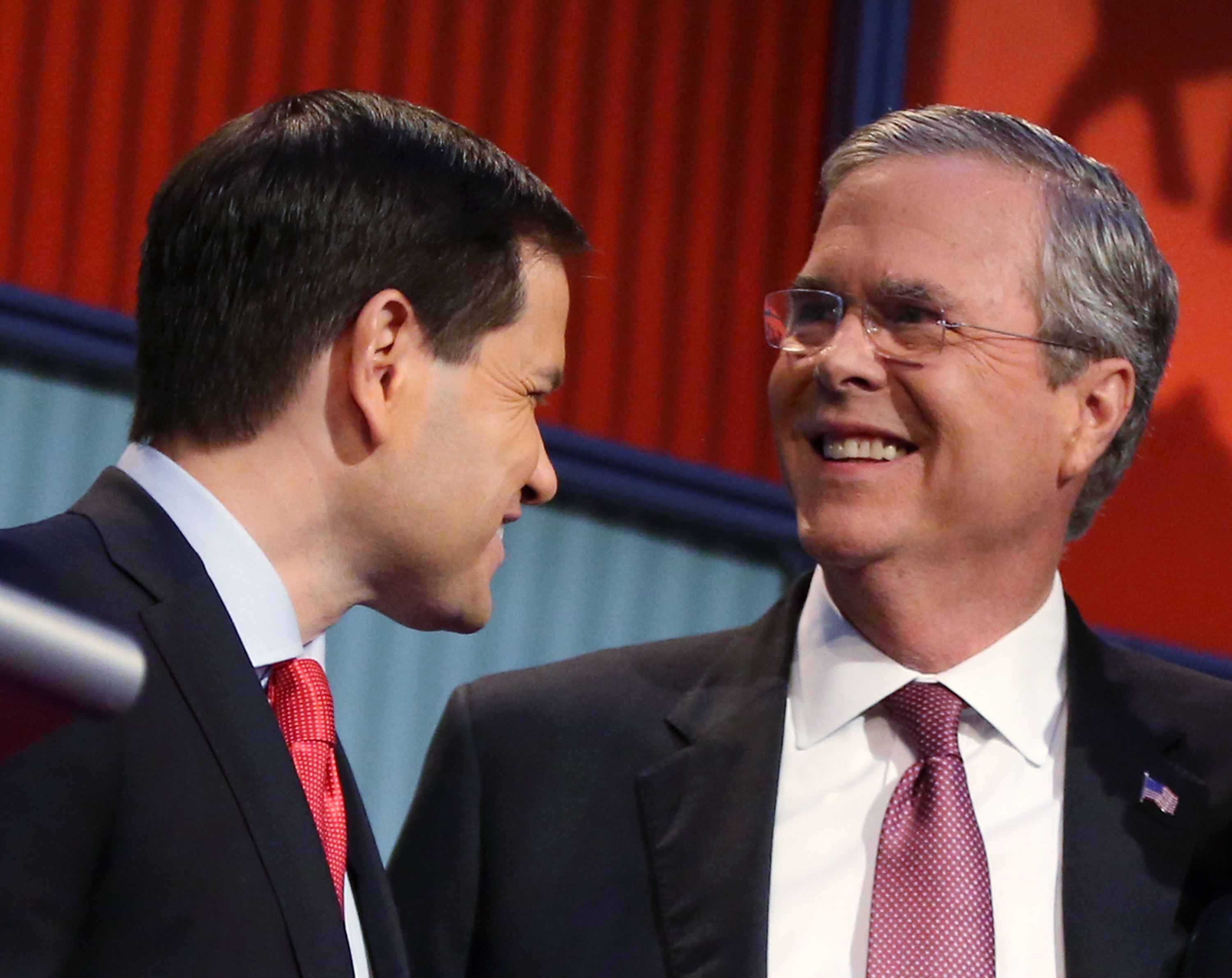 FILE - In this Aug. 6, 2015, photo, Republican presidential candidates Marco Rubio, left, and Jeb Bush talk during a break during the first Republican presidential debate at the Quicken Loans Arena in Cleveland, Ohio.