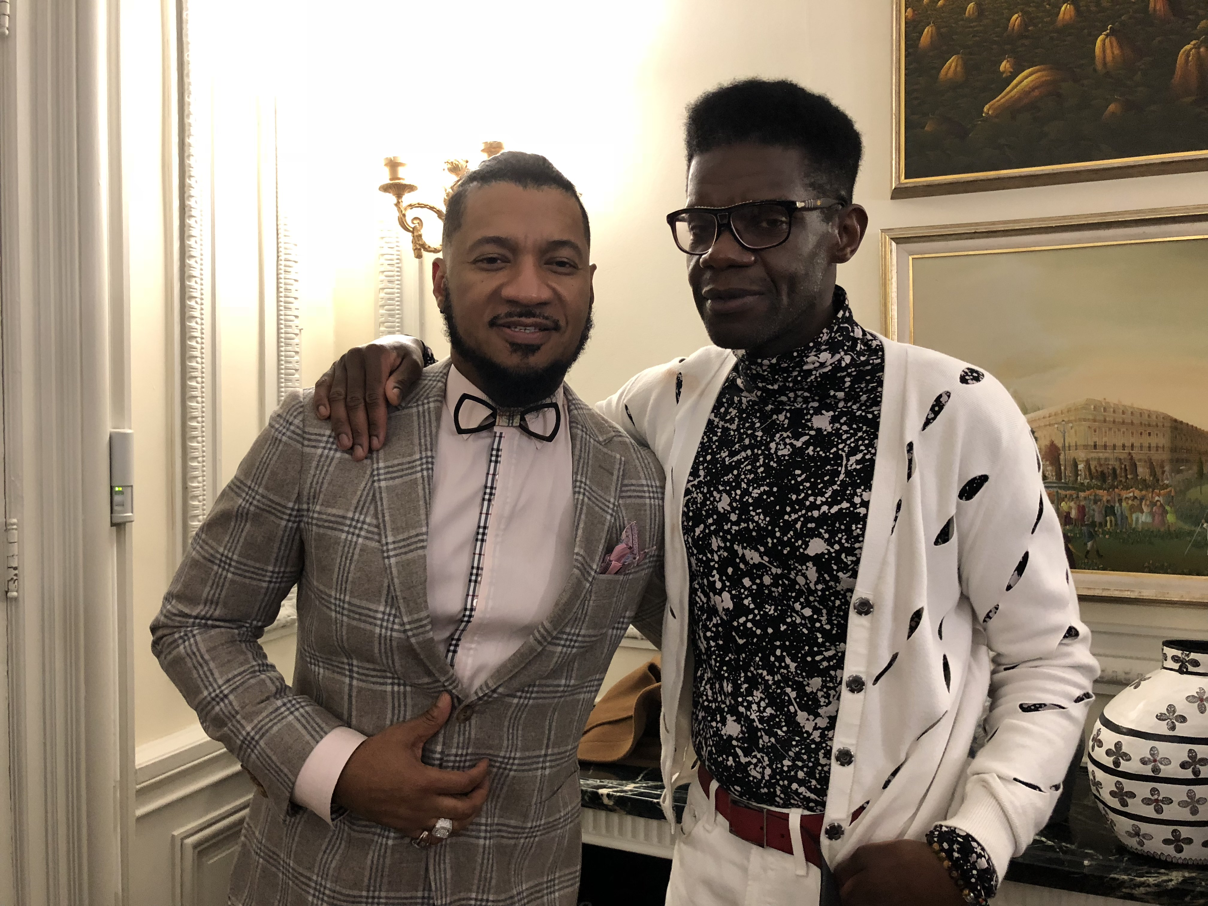 DC Fashion Week founder Ean Williams, left, with Haitian designer Victor Glemaud at the Haitian Embassy fashion event in Washington D.C., Feb. 23, 2018. (Photo: S. Lemaire / VOA)