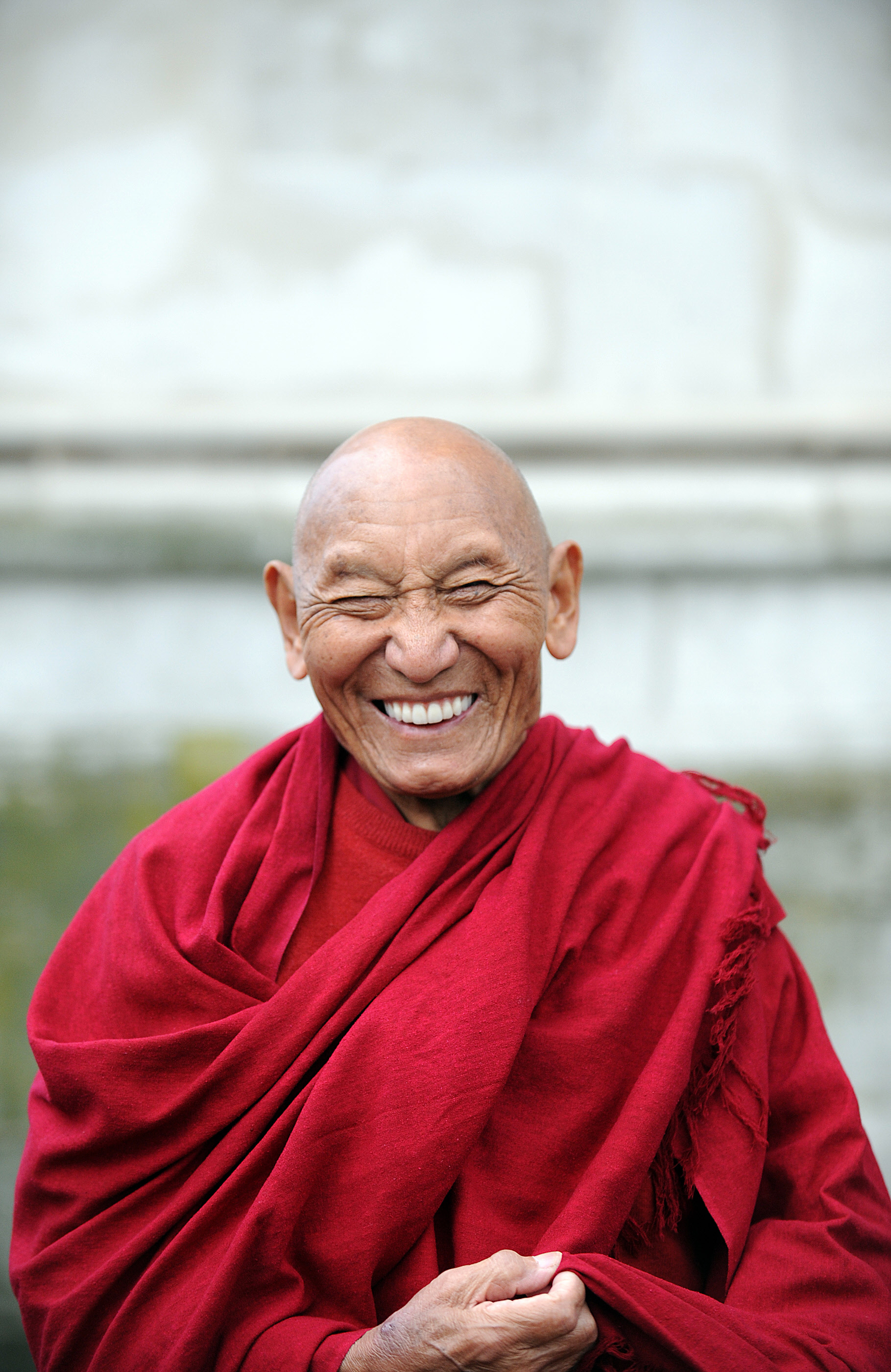 FILE - Tibetan Buddhist monk Palden Gyatso attends a wreath-laying ceremony at the Memorial to Innocent Victims, outside Westminster Abbey in London, March 10, 2009.