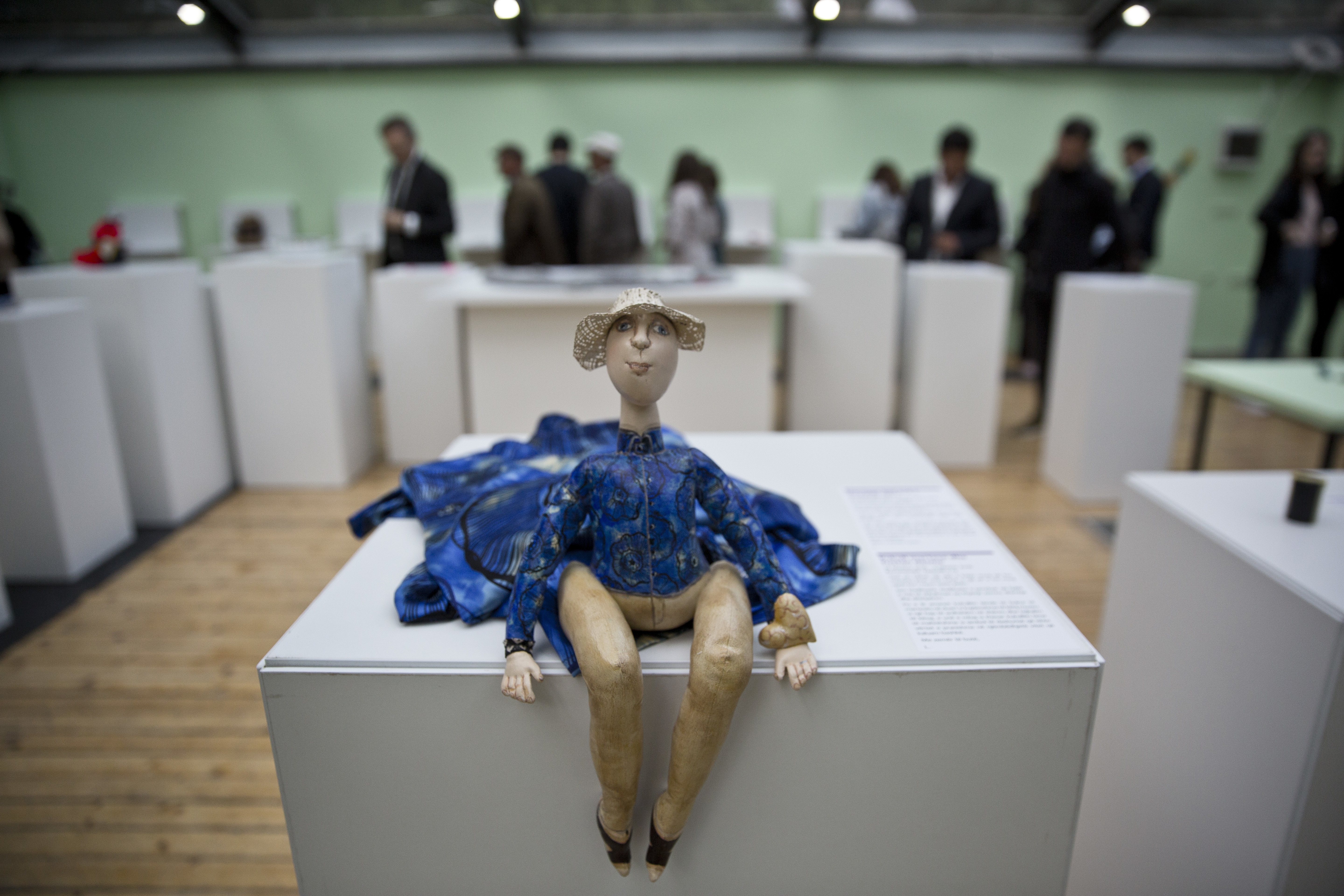 A toy doll is displayed as visitors look at items presented at the Museum of Broken Relationships in Pristina, Kosovo, May 3, 2018.