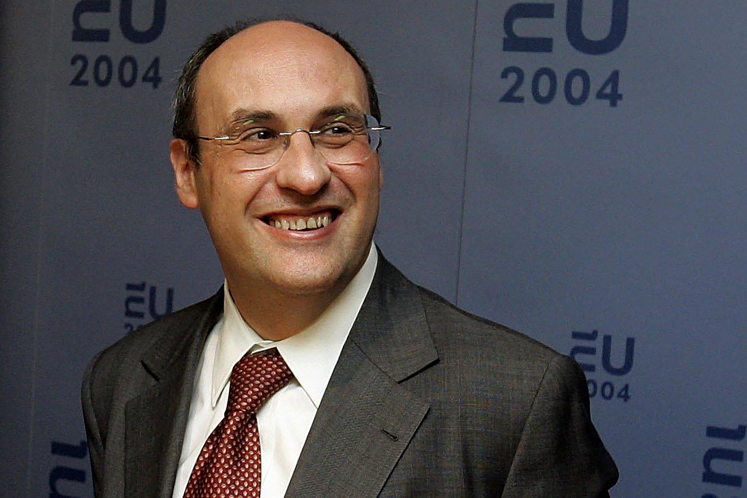 FILE - Then-European Commissioner for Justice and Home Affairs Antonio Vitorino smiles following a meeting between the EU and the U.S. in The Hague, Sept. 18, 2004.