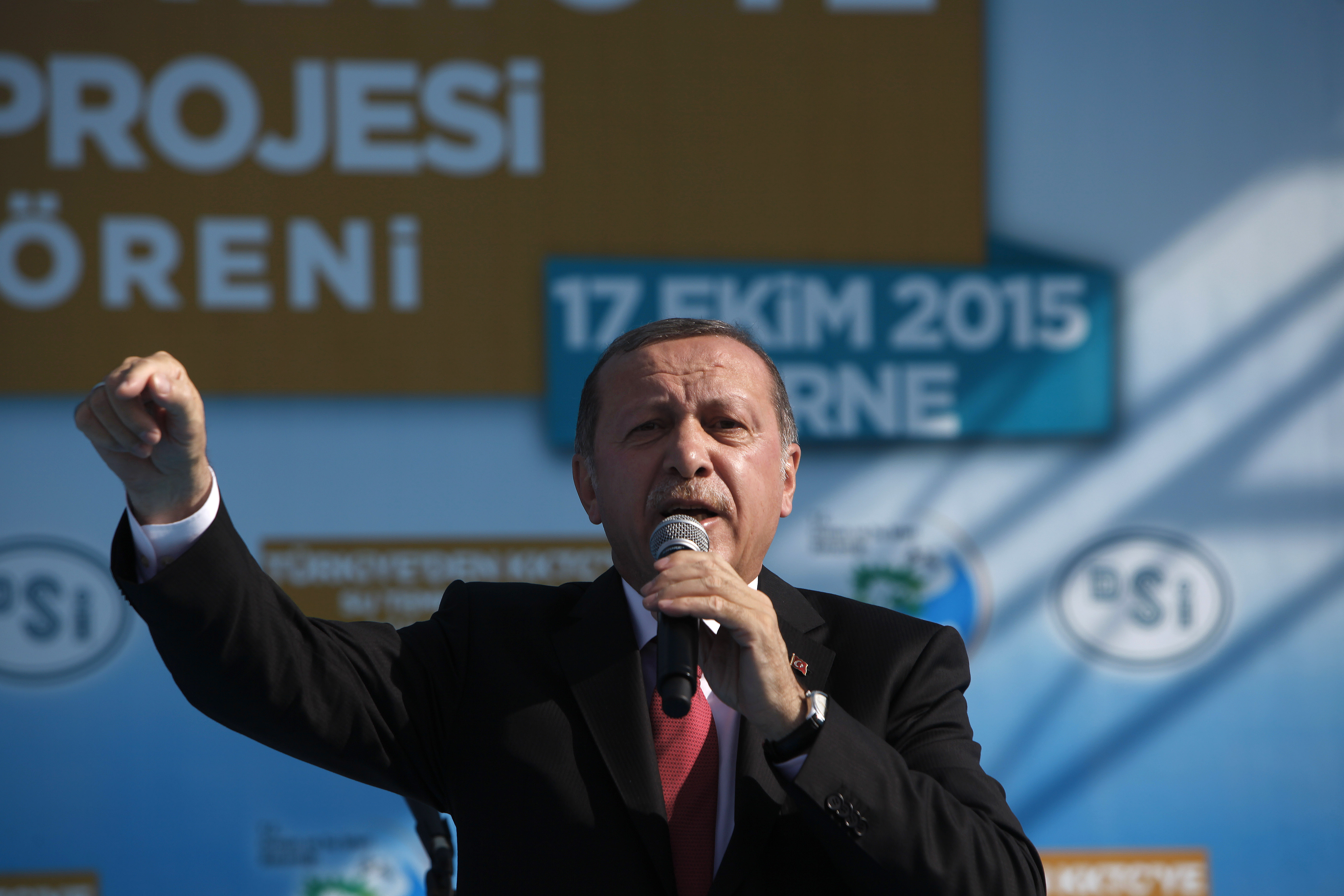 Turkish President Recep Tayyip Erdogan speaks to his supporters during an inauguration for an undersea pipeline to carry fresh water from Turkey to the breakaway Turkish Cypriot north of ethnically split Cyprus in Mirtou village, Oct. 17, 2015.