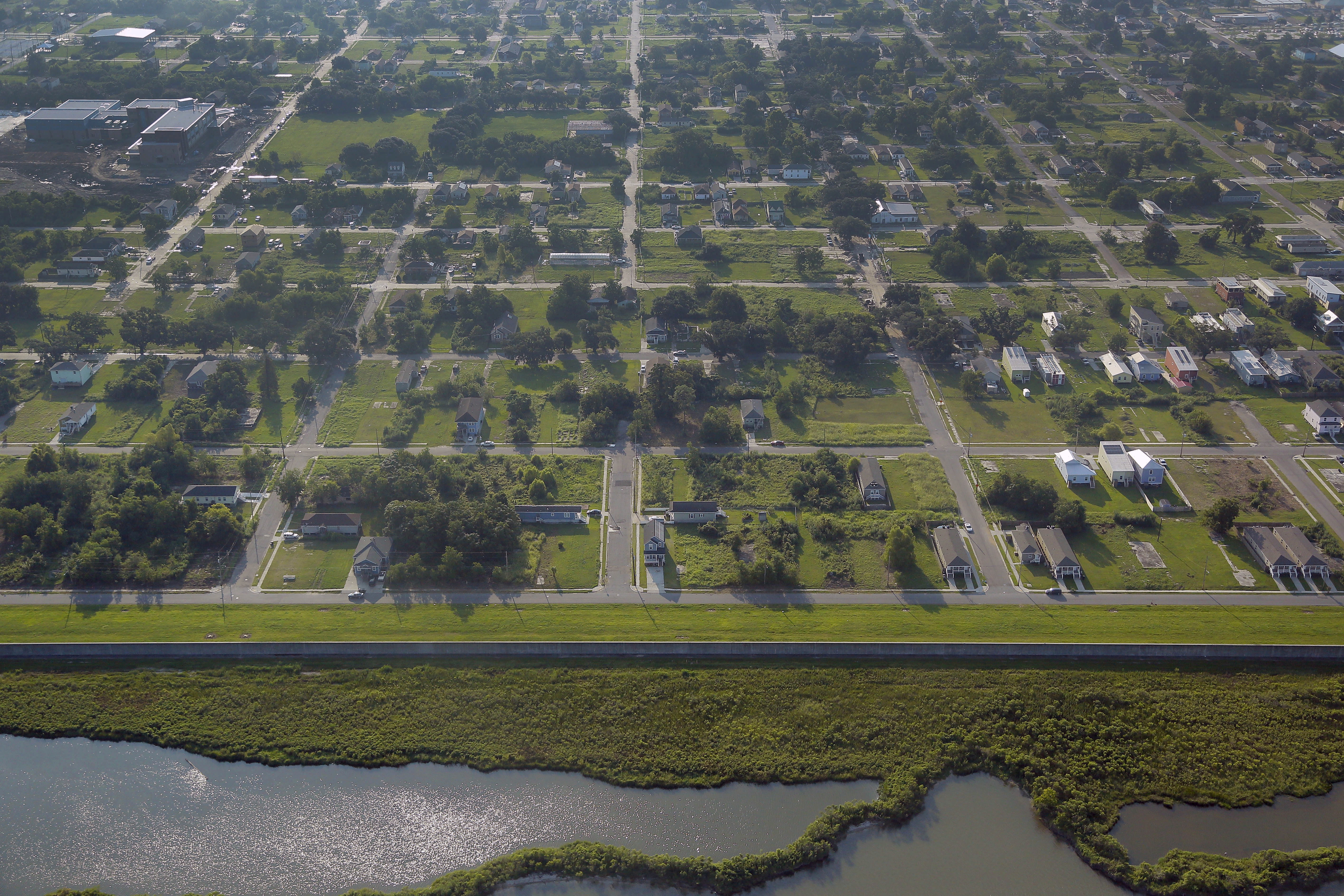 FILE - Empty lots are seen scattered throughout the Lower Ninth Ward neighborhood of New Orleans, Louisiana, Aug. 25, 2015.