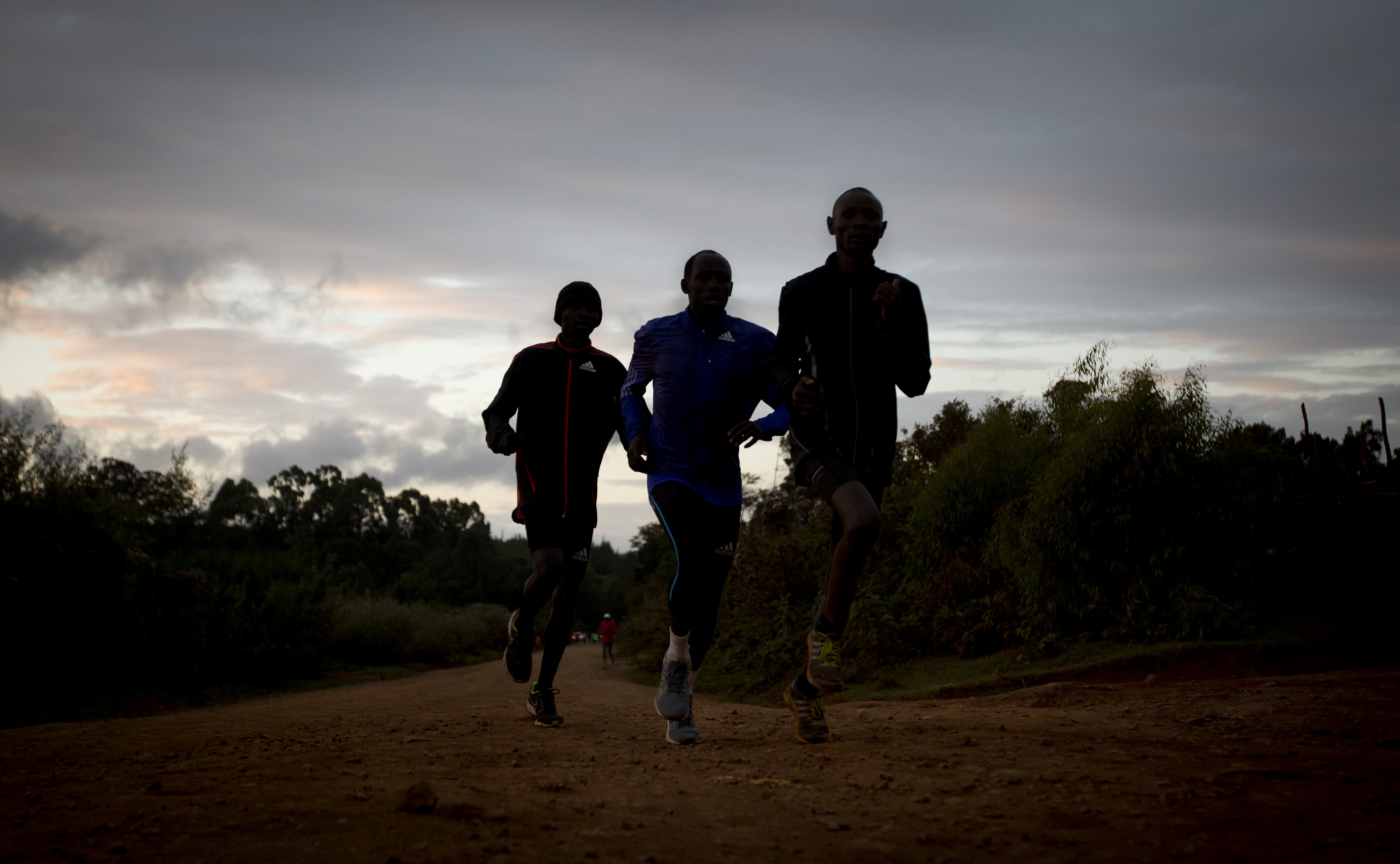 Kenyan athletes train just after dawn, in Kaptagat Forest in western Kenya. World Anti-Doping Agency (WADA) officials declared Kenya's drug-fighting agency out of compliance, May 12, 2016, a move that places the track powerhouse's participation in th...