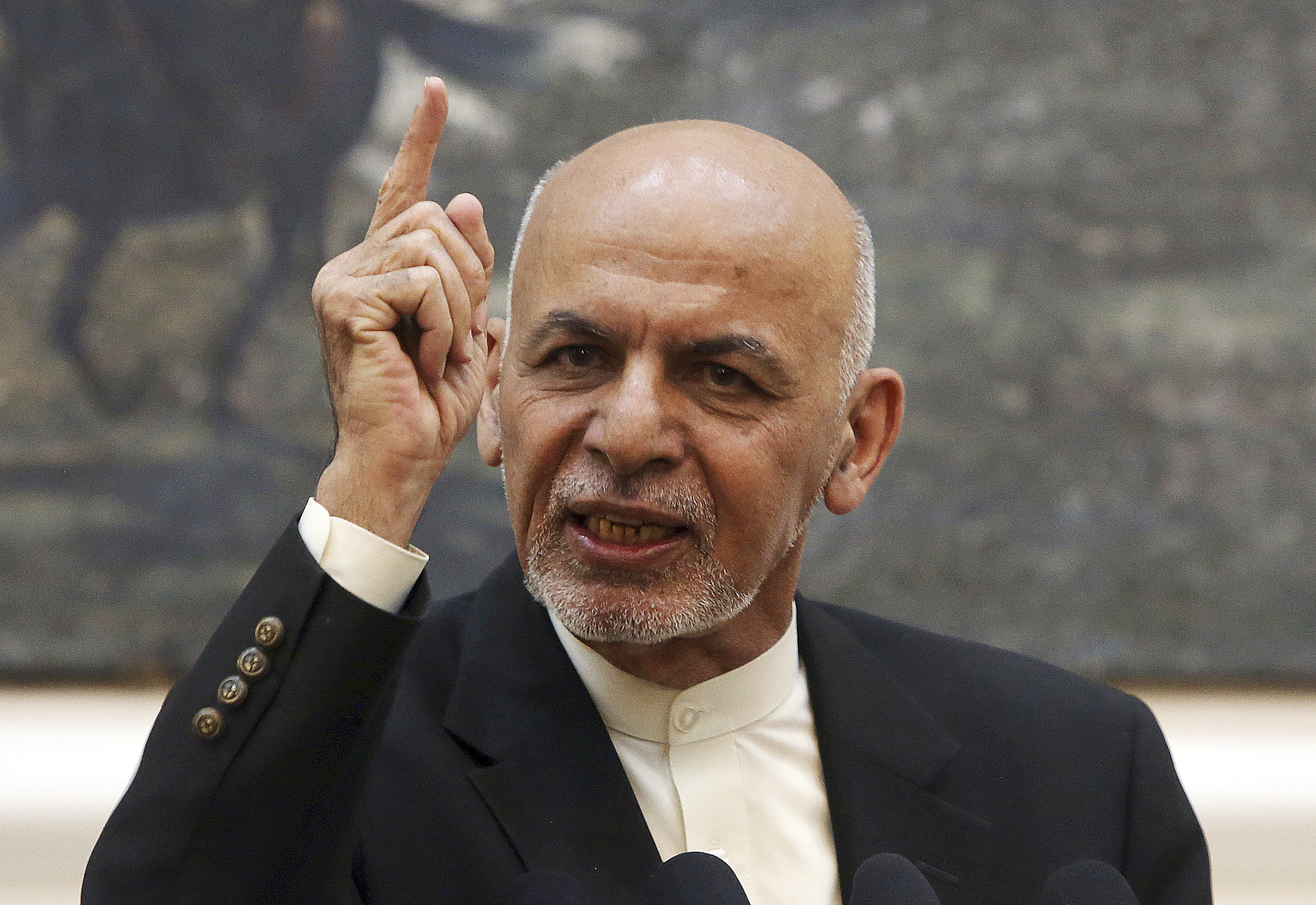 FILE - Afghan President Ashraf Ghani speaks during a press conference at the presidential palace in Kabul, Afghanistan, July 15, 2018.