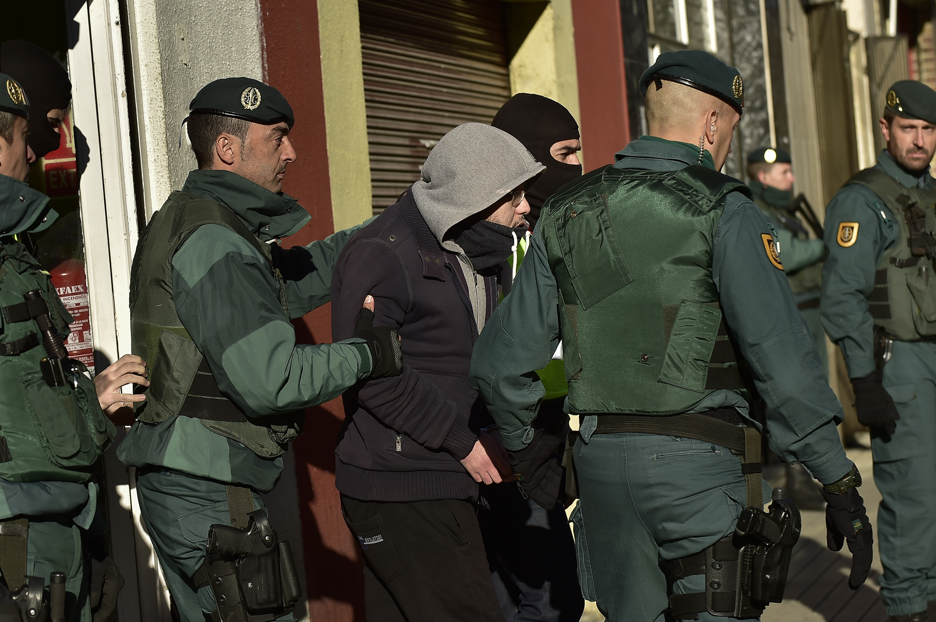FILE - A unidentified Moroccan leaves a tea shop detained by the Spanish Civil Guard in Pamplona, northern Spain, Dec.1, 2015. Spanish authorities alleged the man was a member of a cell that recruited fighters for the Islamic State group in Syria.