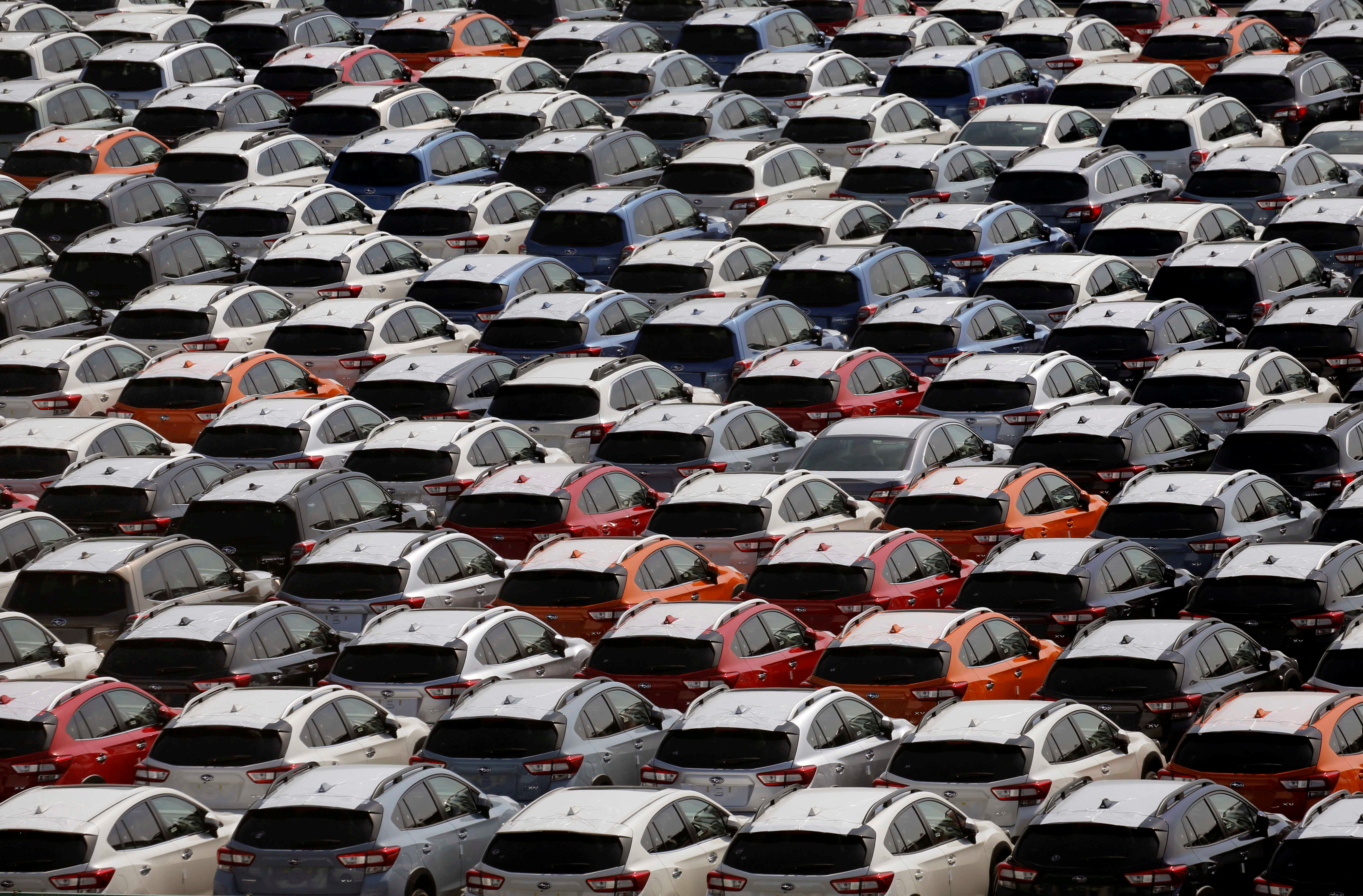 Newly manufactured cars of the automobile maker Subaru await export in a port in Yokohama, Japan May 30, 2017.