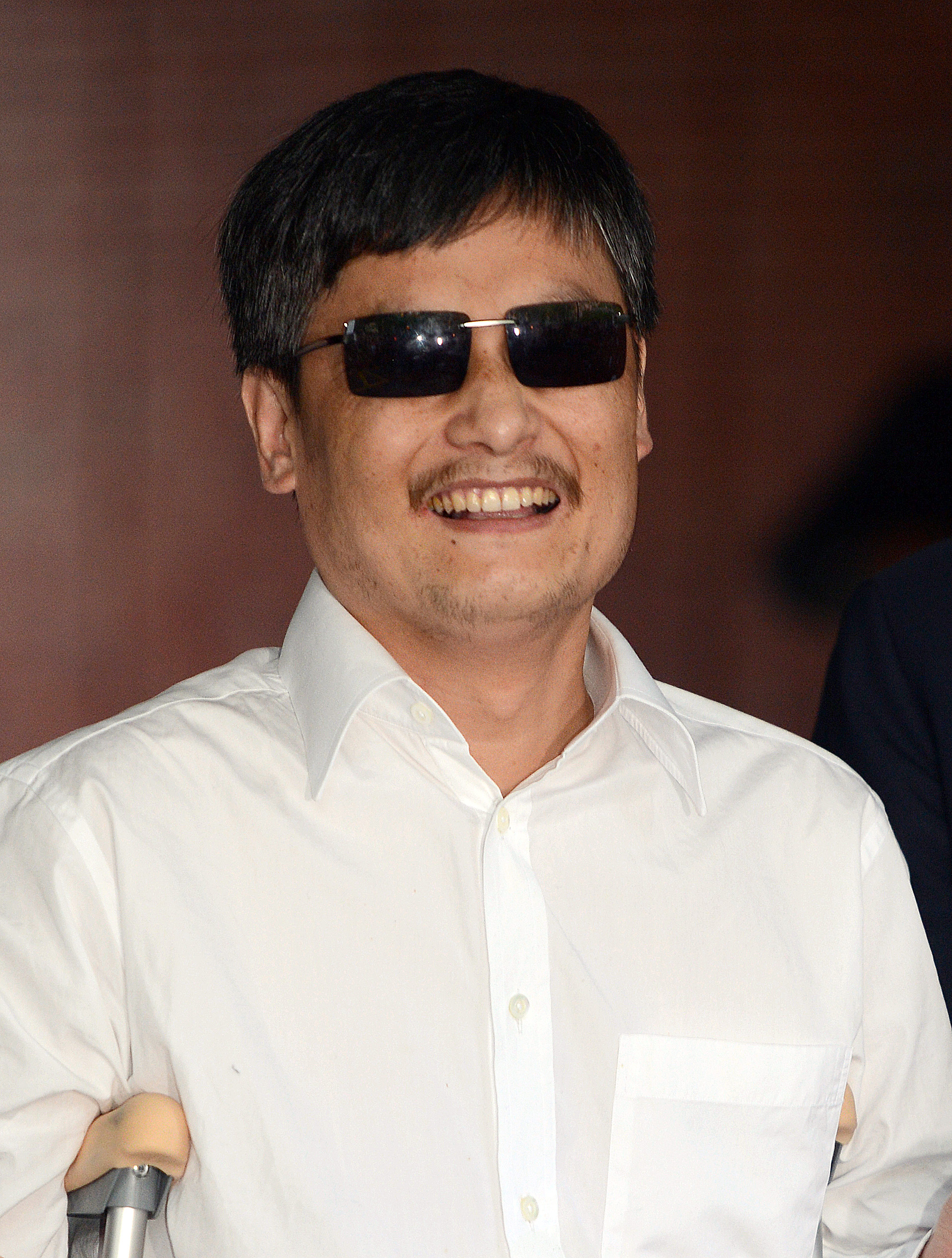 Blind Chinese legal activist Chen Guangcheng arrives at Washington Square Village on the campus of New York University, May 19, 2012, in New York.