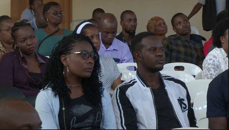 Youths follow proceedings as leaders tell them about the dangers of taking drugs.