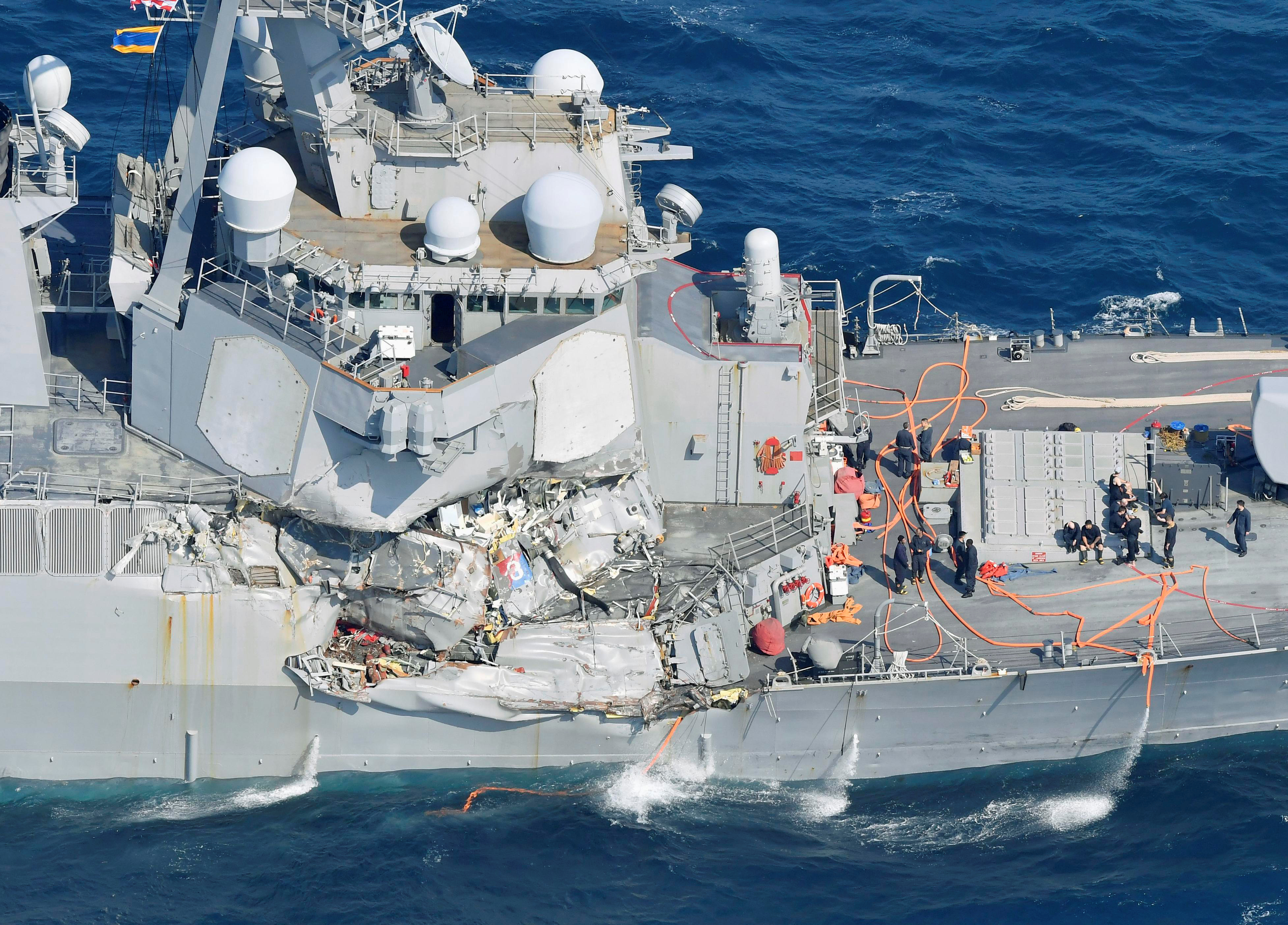 The Arleigh Burke-class guided-missile destroyer USS Fitzgerald, damaged by colliding with a Philippine-flagged merchant vessel, is seen off Shimoda, Japan, June 17, 2017, in this photo taken by Kyodo.