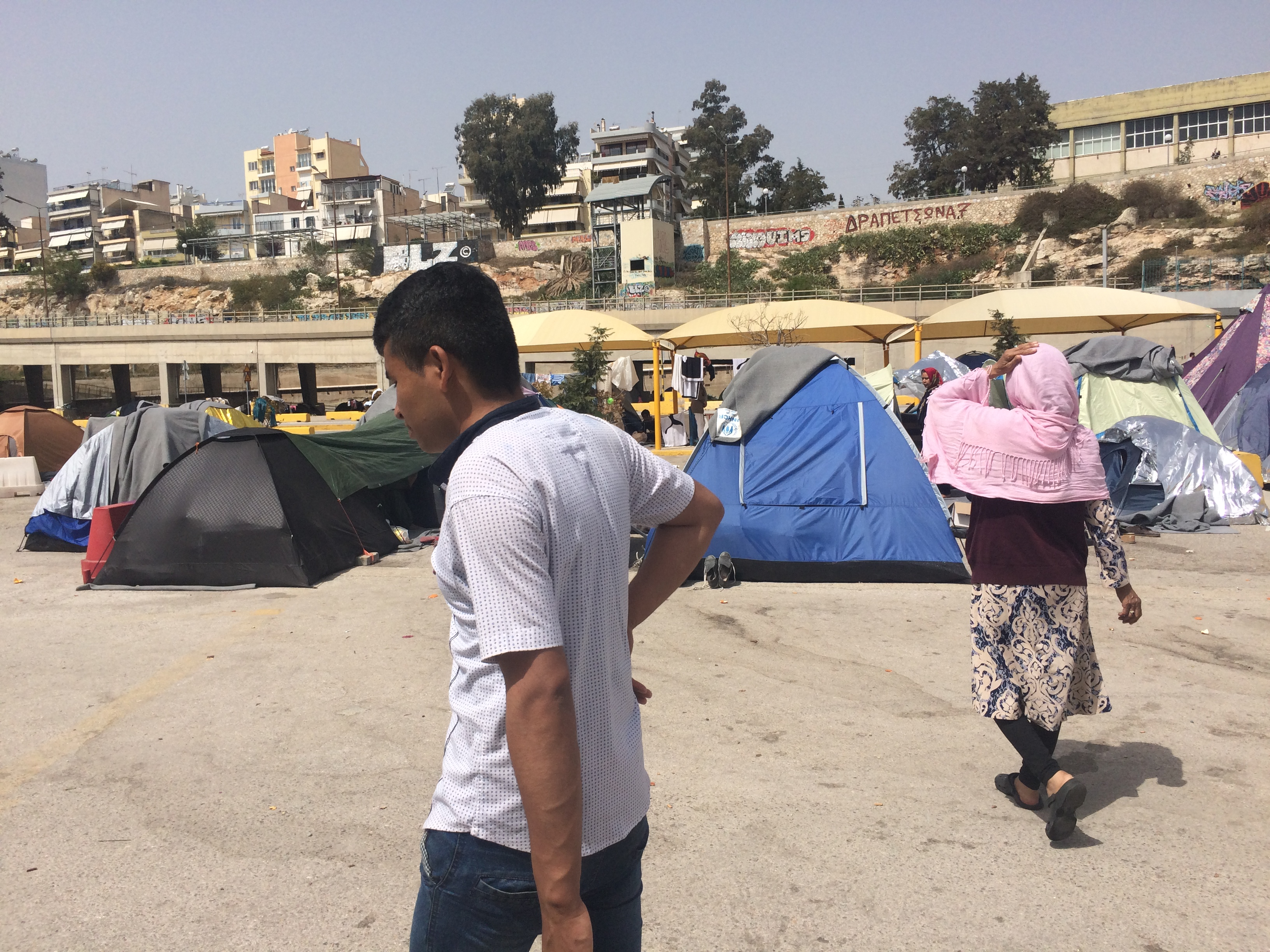 "The Greek government says it will close settlements on the port that house thousands of people.  Many say they don't plan to go to ""official"" camps for fear of worse conditions or being detained, taken in Athens, Greece on April, 8, 2016. (H. Murdock..."