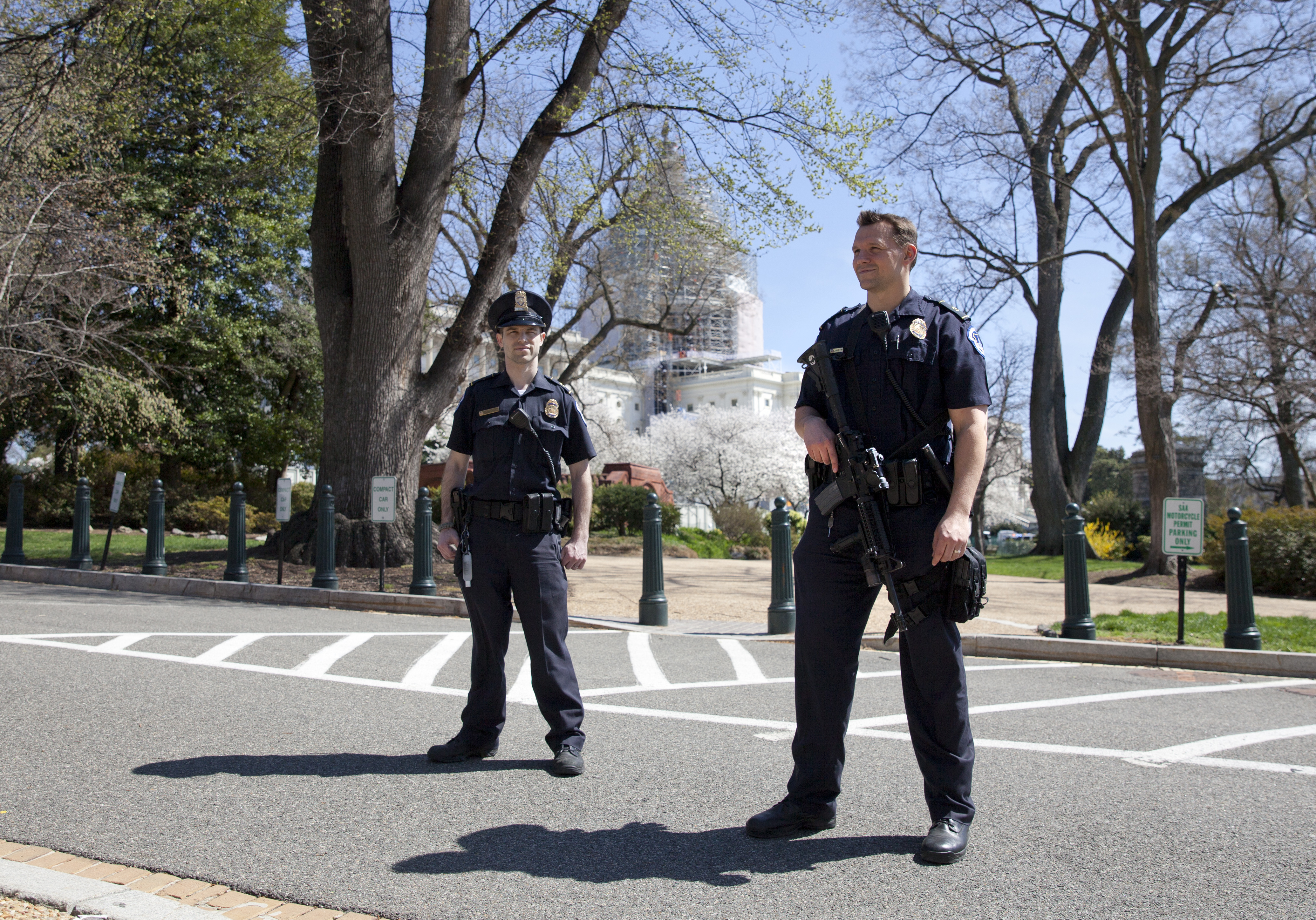 Members of law enforcement keep watch around the north front of the U.S. Capitol in Washington, which was locked down after a gunshot sounded, April 11, 2015.