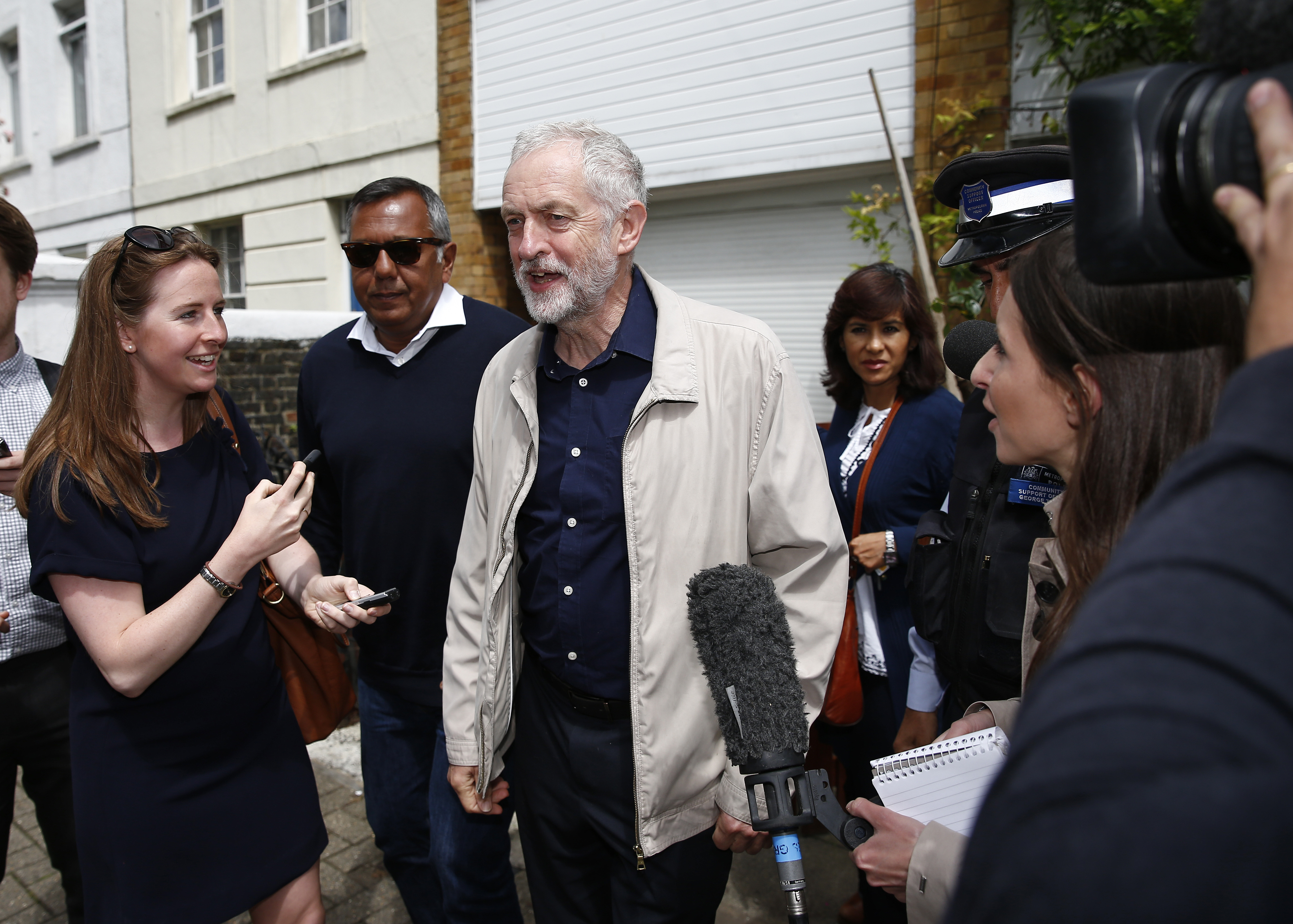 Britain's opposition Labour Party leader Jeremy Corbyn (C) leaves his home in London, June 26, 2016.