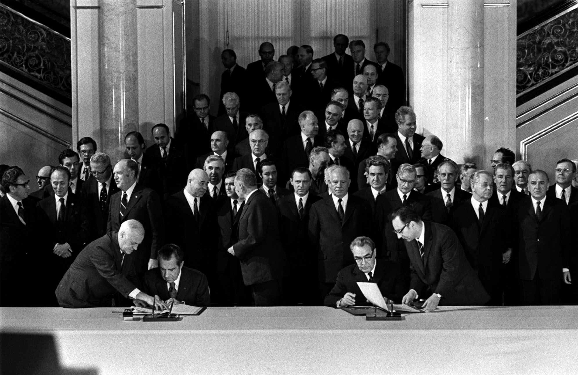 FILE - President Richard Nixon and Soviet Communist Party leader Leonid Brezhnev afix their signatures to the Strategic Arms Limitations agreement in Vladmir Hall of the Kermlin, Moscow, May 26, 1972.