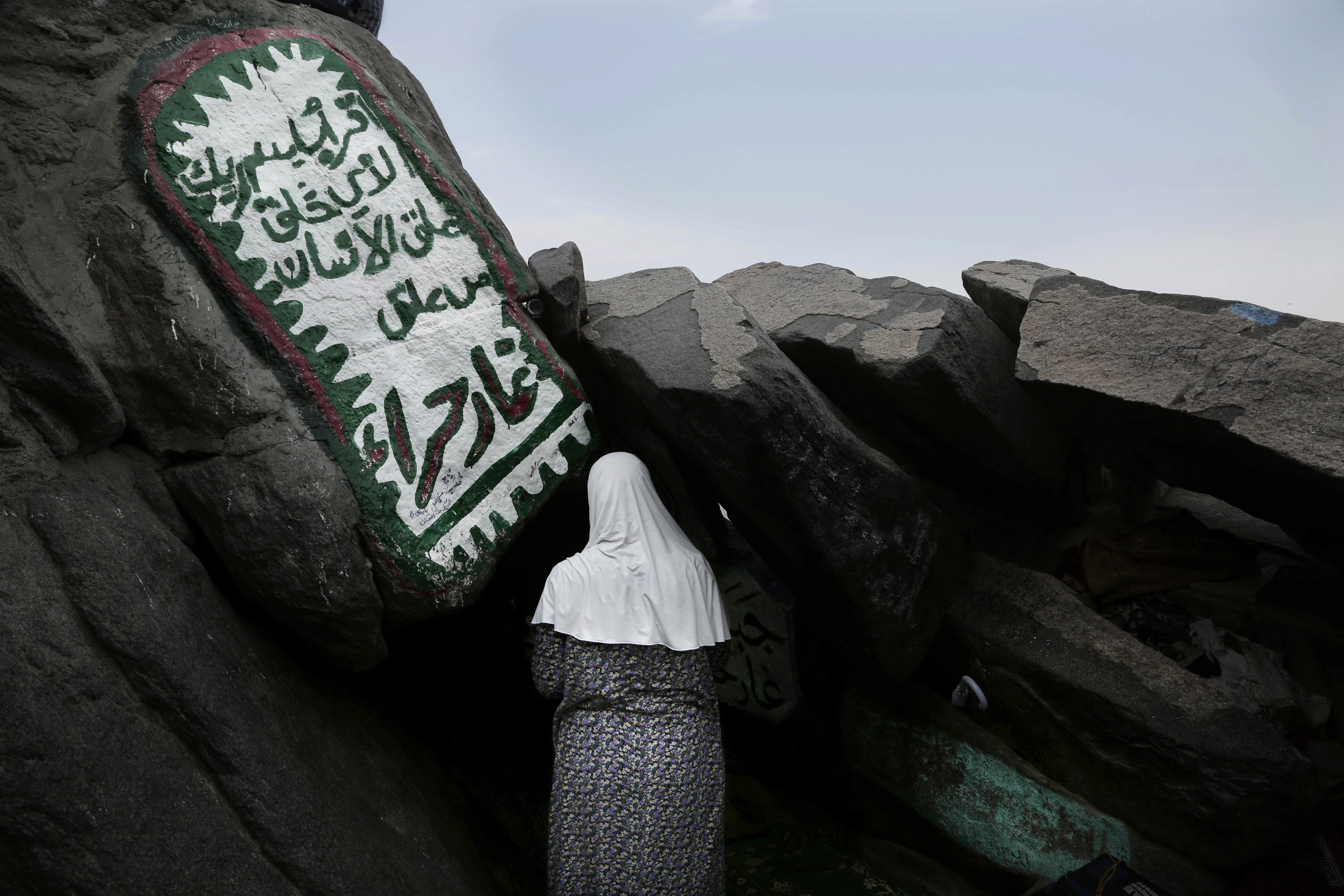 A Turkish Muslim woman prays inside Hiraa cave, where the Prophet Muhammad received his first revelation from God to preach Islam, on Noor Mountain, on the outskirts of Mecca, Saudi Arabia, Sept. 9, 2016.