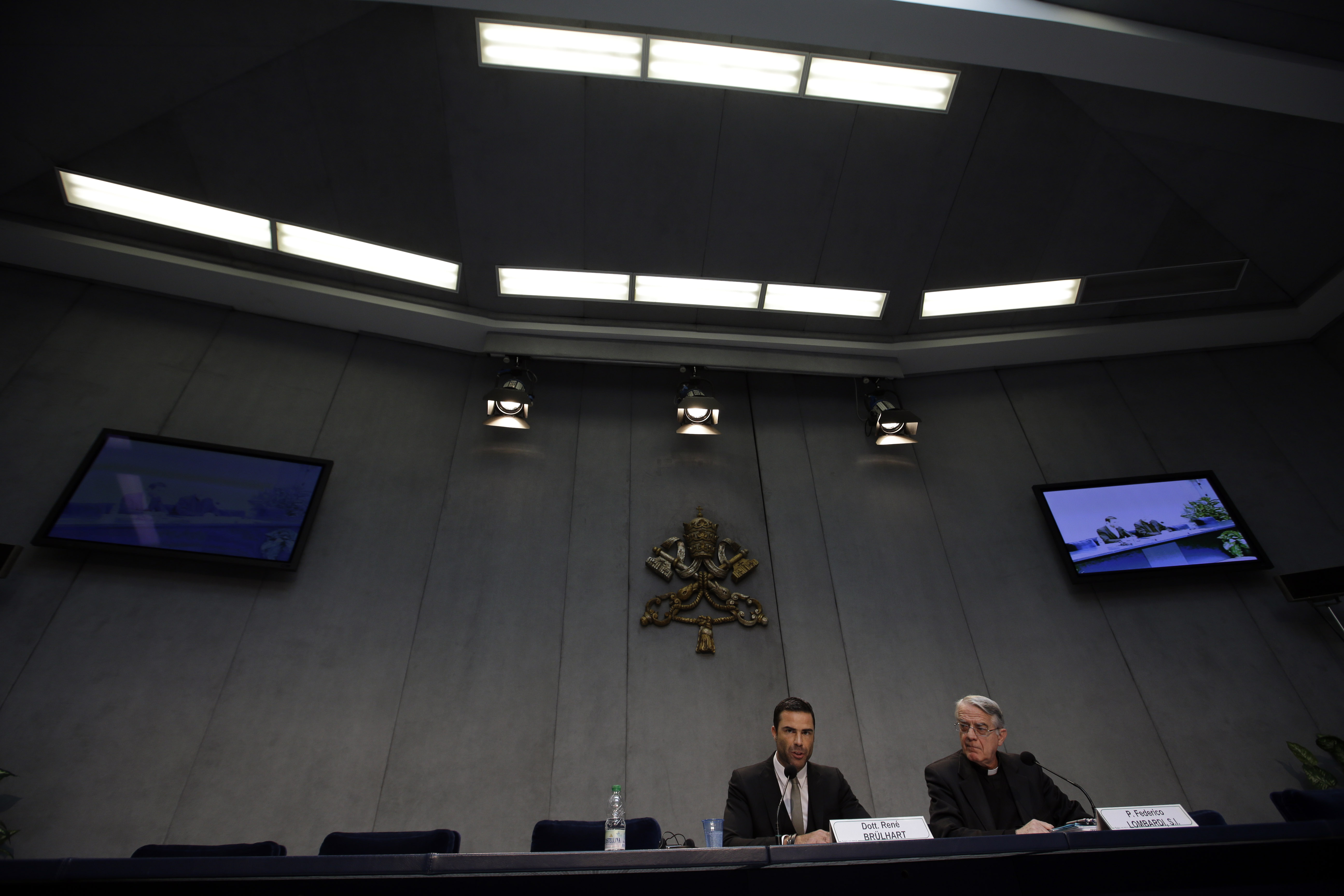 FILE - Rene Brulhart, director of the Financial Information Authority, an institution established to monitor the monetary and commercial activities of Vatican agencies, and Vatican spokesman Federico Lombardi, are seen at the Vatican, May 22, 2013.