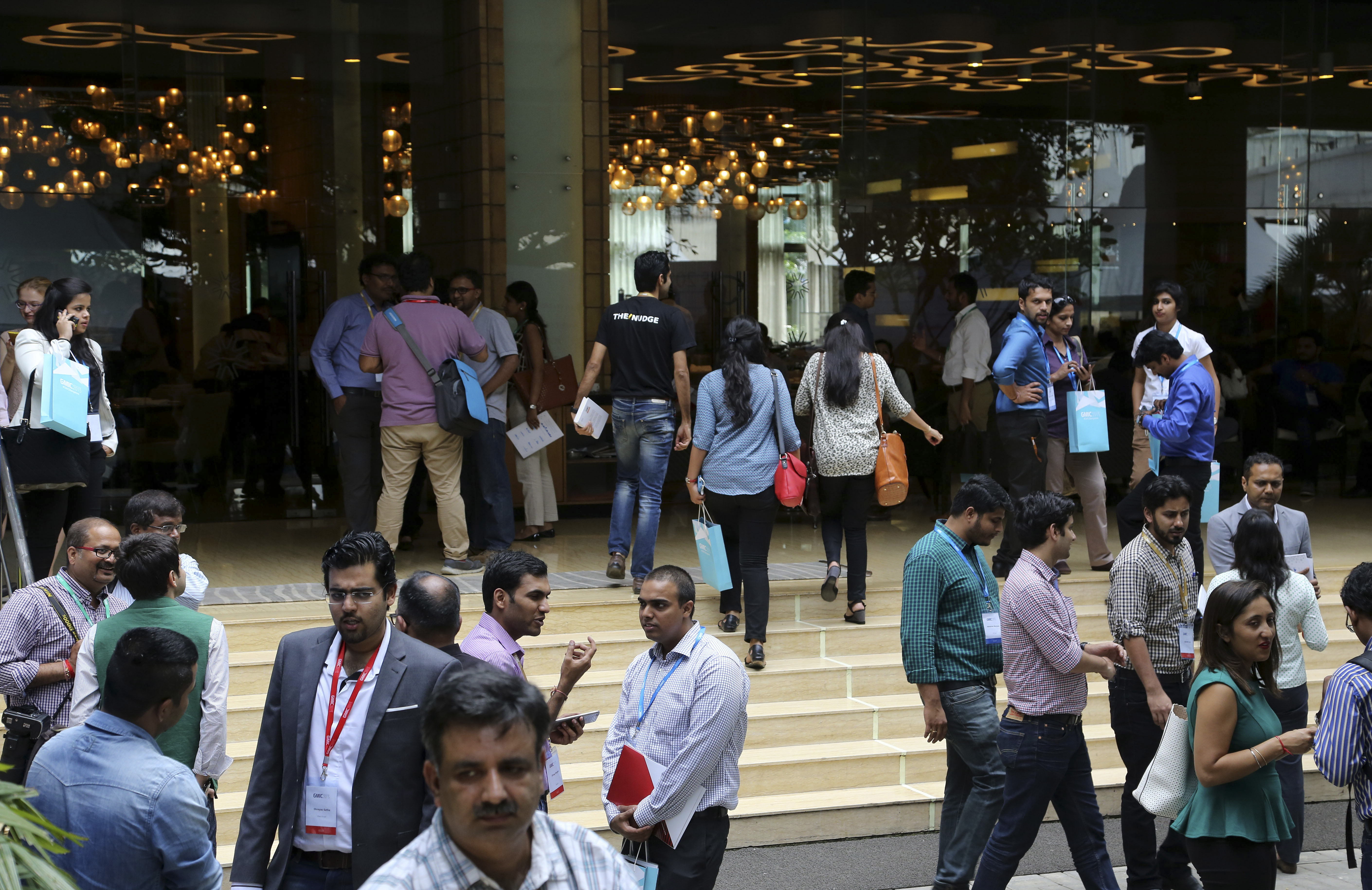 FILE - Visitors crowd at the Global Mobile Internet Conference in Bangalore, India, Sept. 10, 2015.