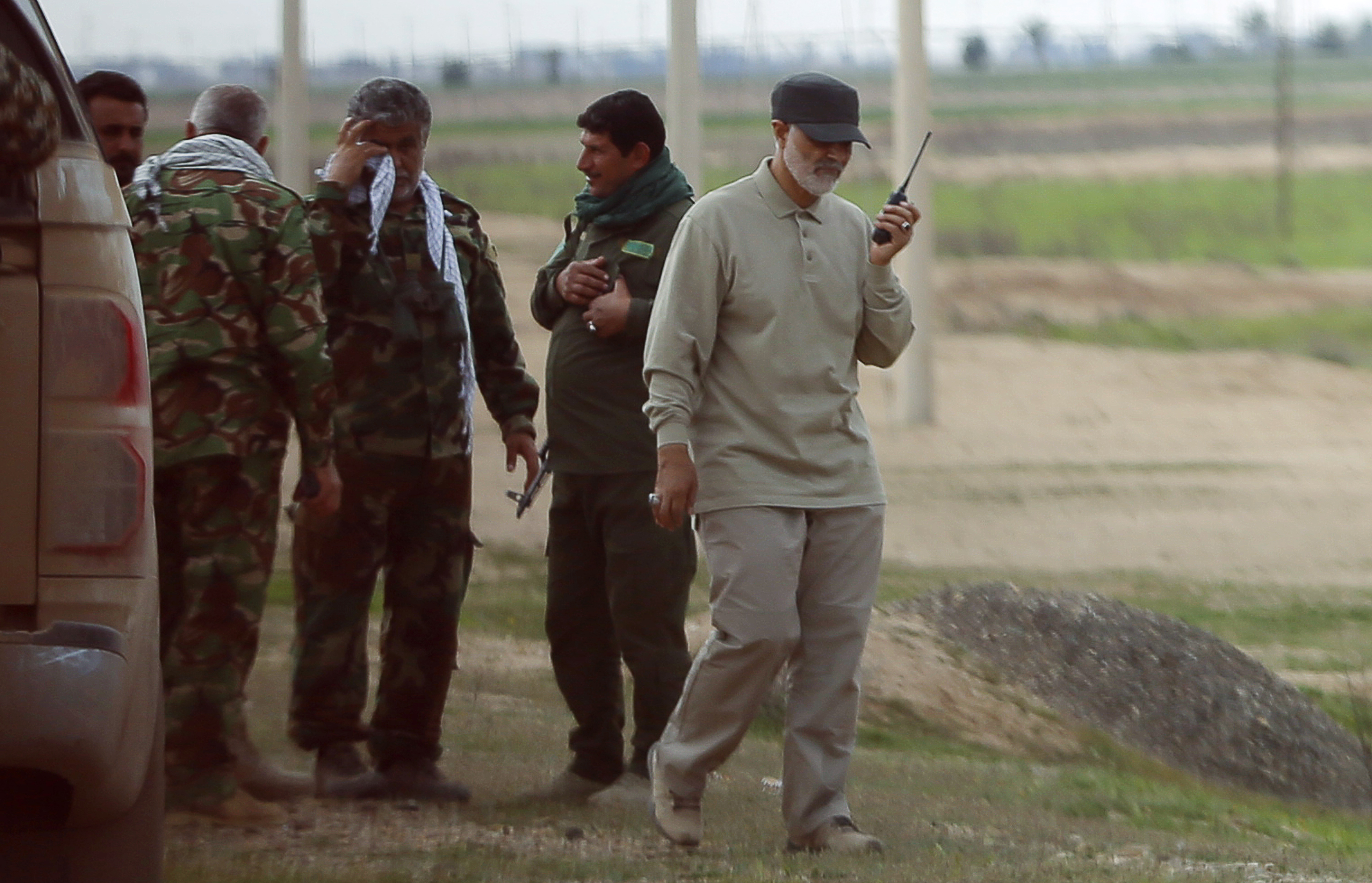 Iranian Major General Qassem Soleimani uses a walkie-talkie at the front line during offensive operations against Islamic State militants in the town of Tal Ksaiba in Salahuddin province, Iraq, March 8, 2015.