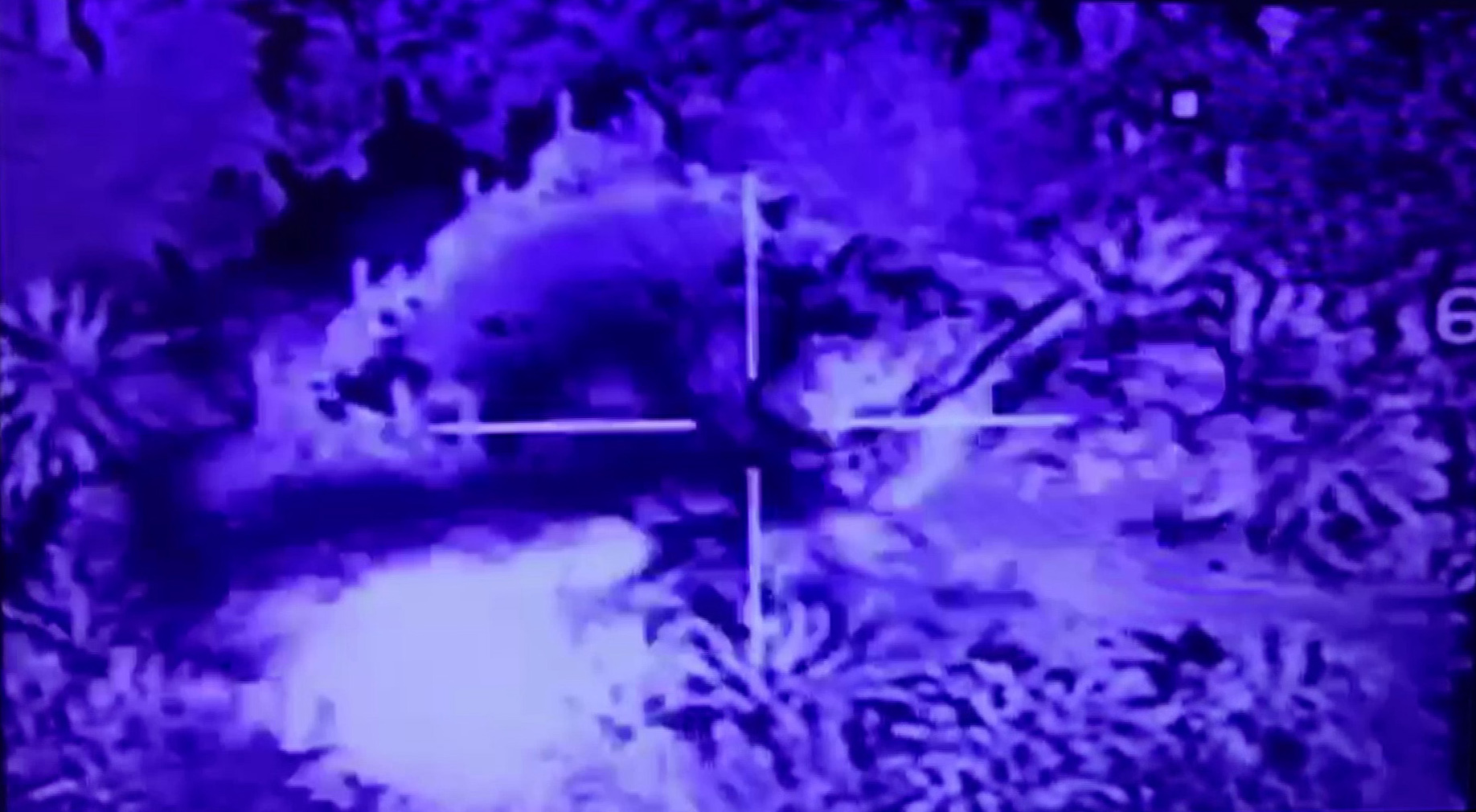 FILE - An image grab taken from a video released by the Iraqi Security Media Center on May 25, 2018, shows an airstrike by the Iraqi air force targeting a huge building in the Syrian area of Hajin, near the border with Iraq. Iraq was carrying out air...