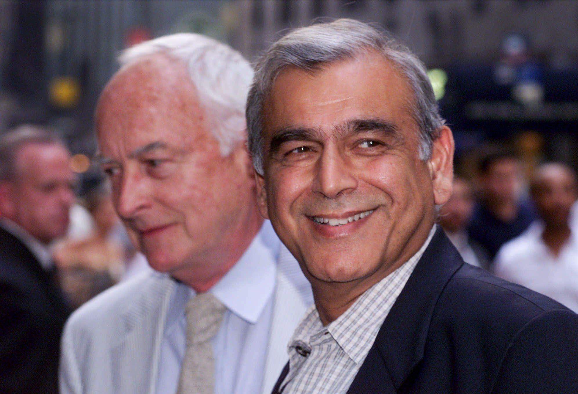 FILE - In this July 27, 1999, photo, film director James Ivory, left, and producer Ismail Merchant arrive for an auction of movie memorabilia at a hotel in New York.