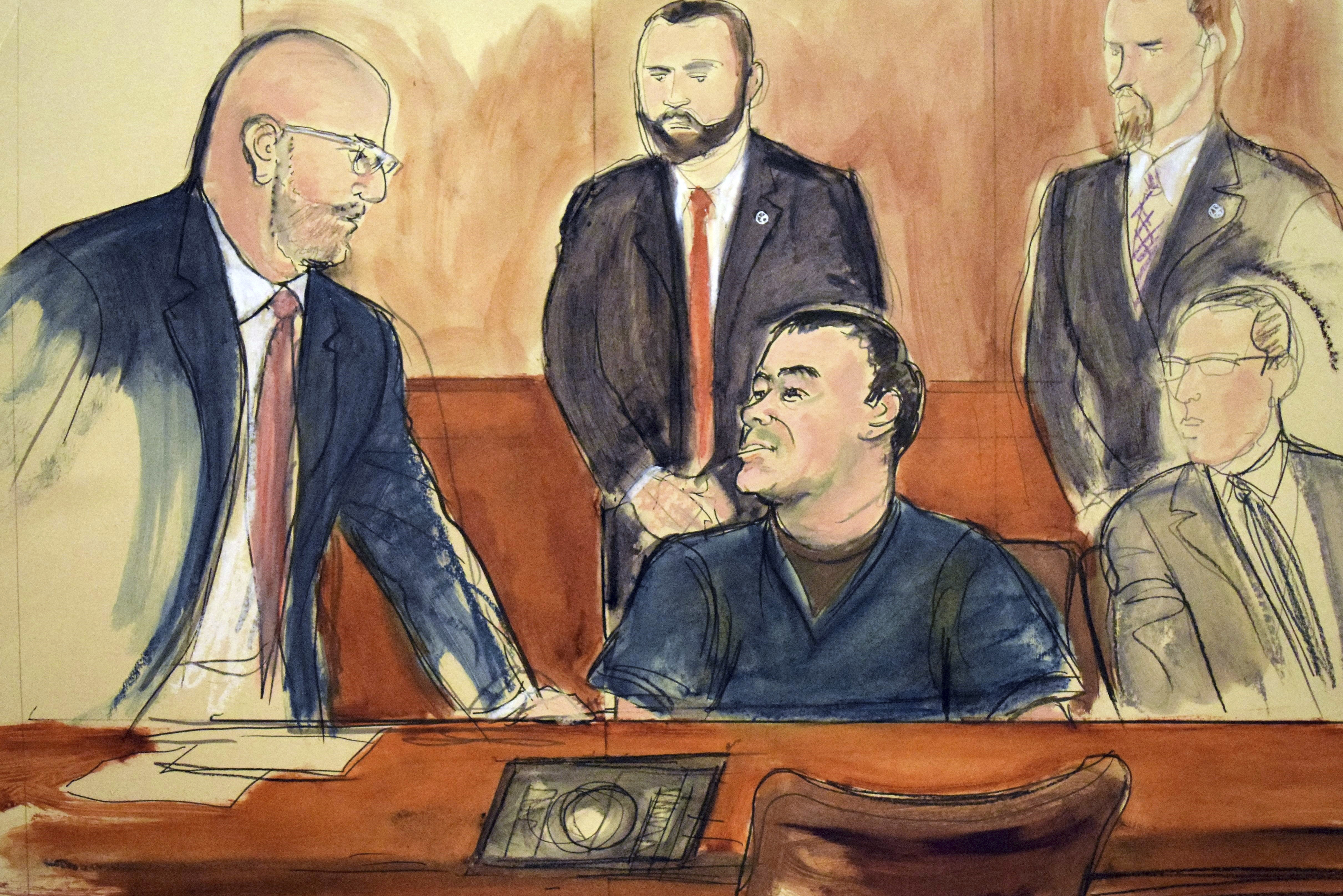 """In this courtroom drawing, Joaquin """"El Chapo"""" Guzman, seated center, speaks to his attorney, Eduardo Balarezo, after a judge denied his request to speak directly to the court, Feb. 15, 2018, in New York."""