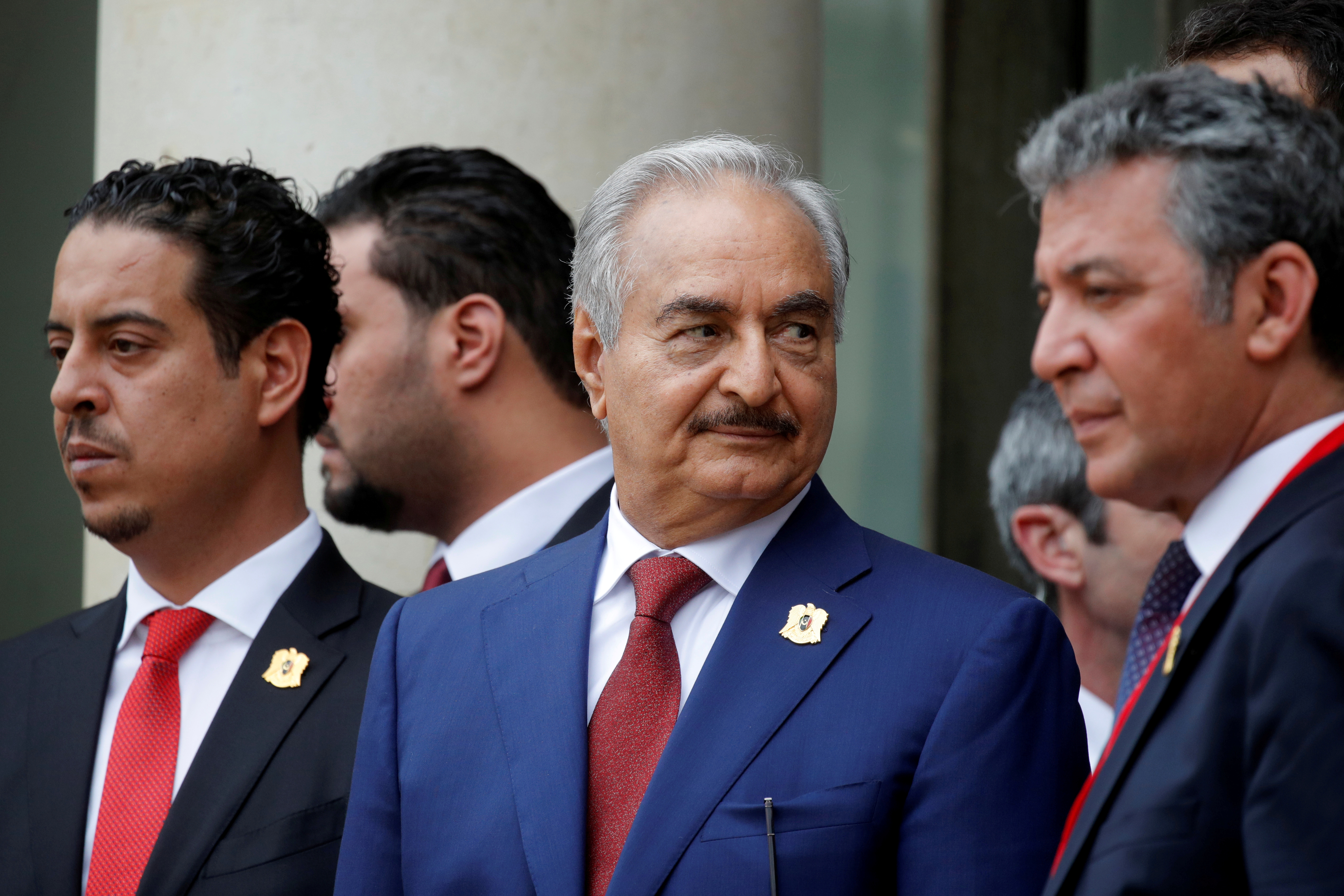 FILE - Khalifa Haftar (C), the military commander who dominates eastern Libya, leaves after an international conference on Libya in Paris, France, May 29, 2018.