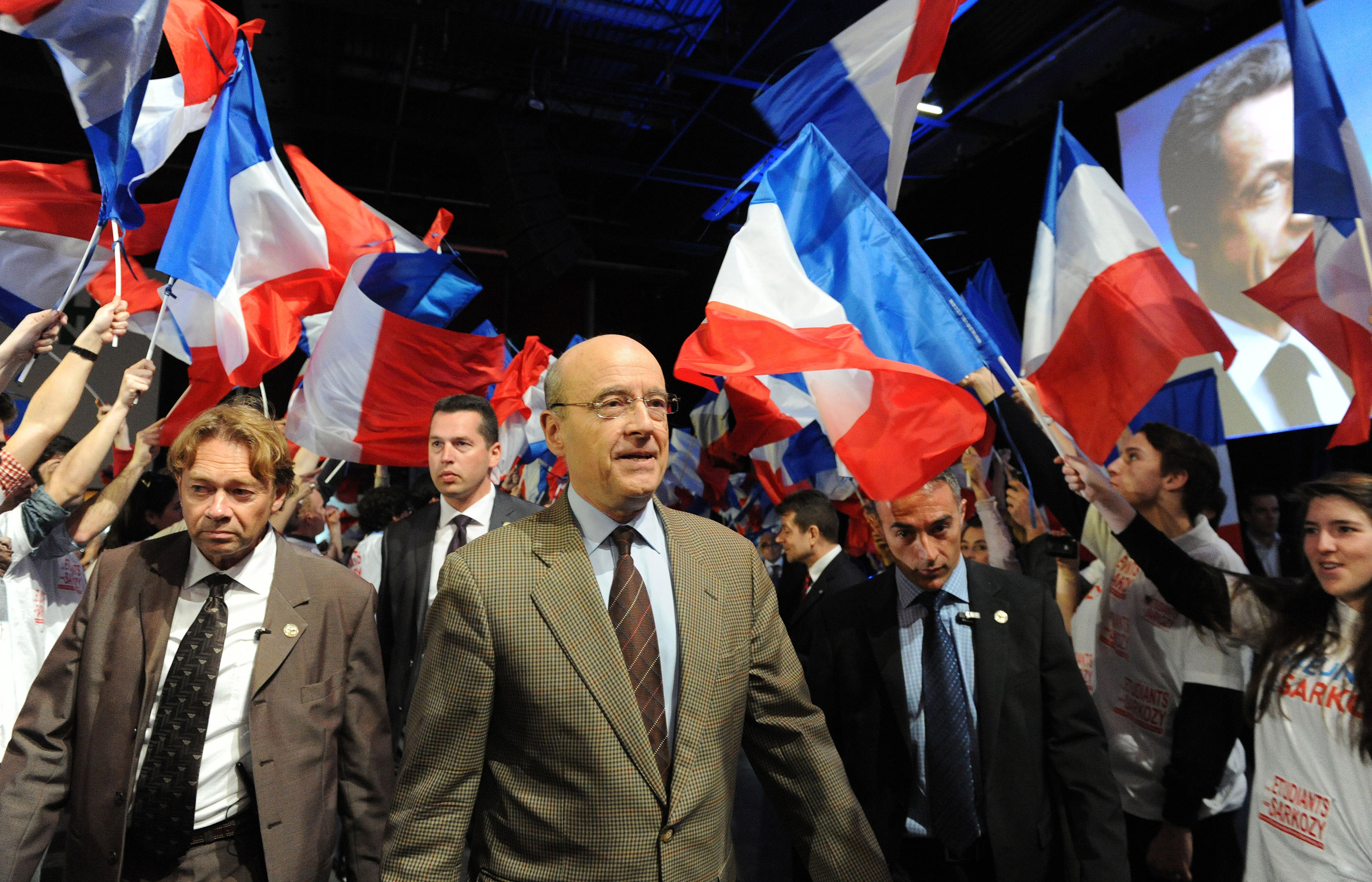 FILE - French Foreign Minister Alain Juppe (C) arrives at a meeting in Bordeaux, western France, March 3, 2012.