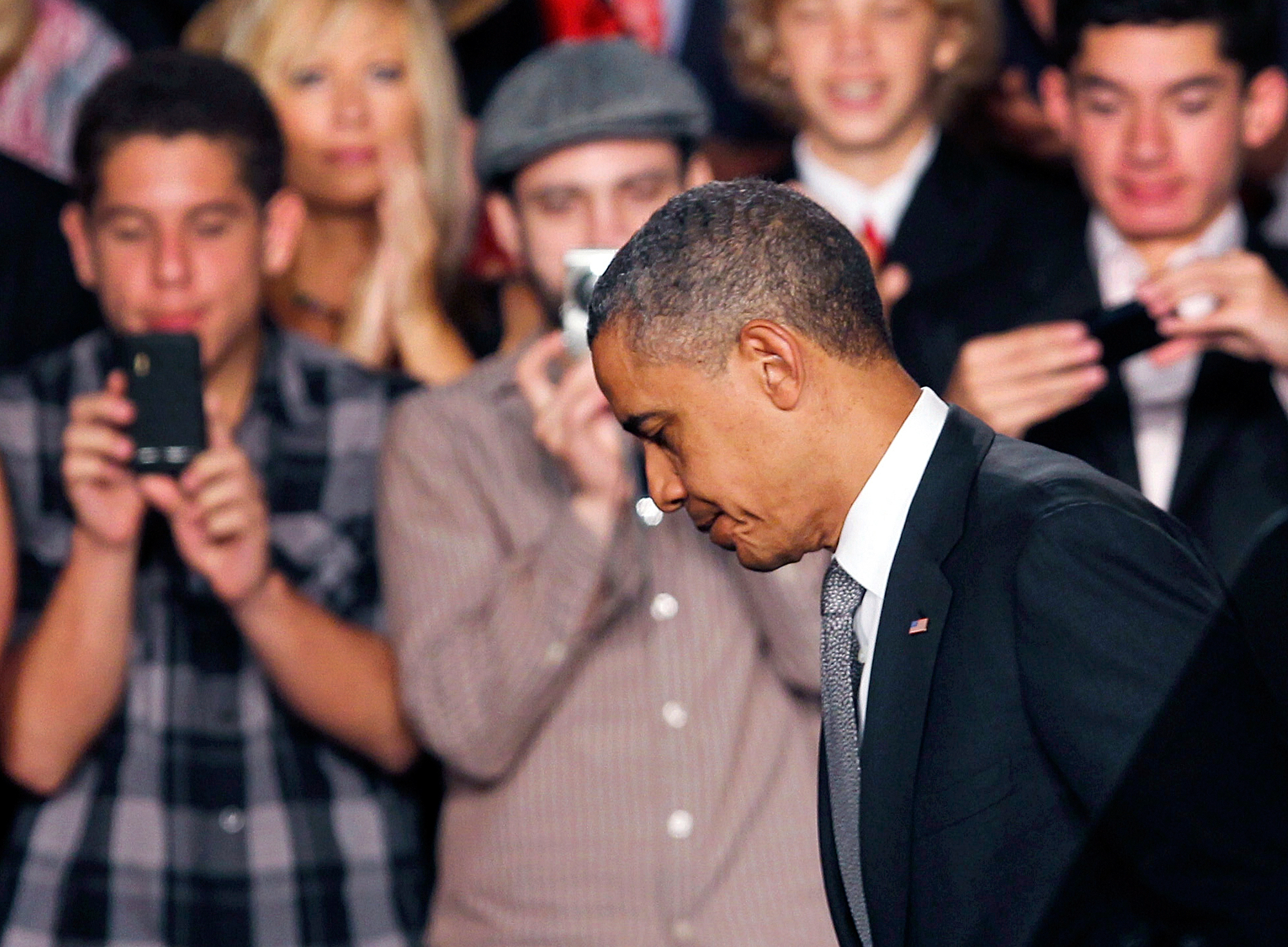 President Barack Obama walks off the stage after speaking about the Aurora, Colorado shooting in Fort Myers, Florida, July 20, 2012.