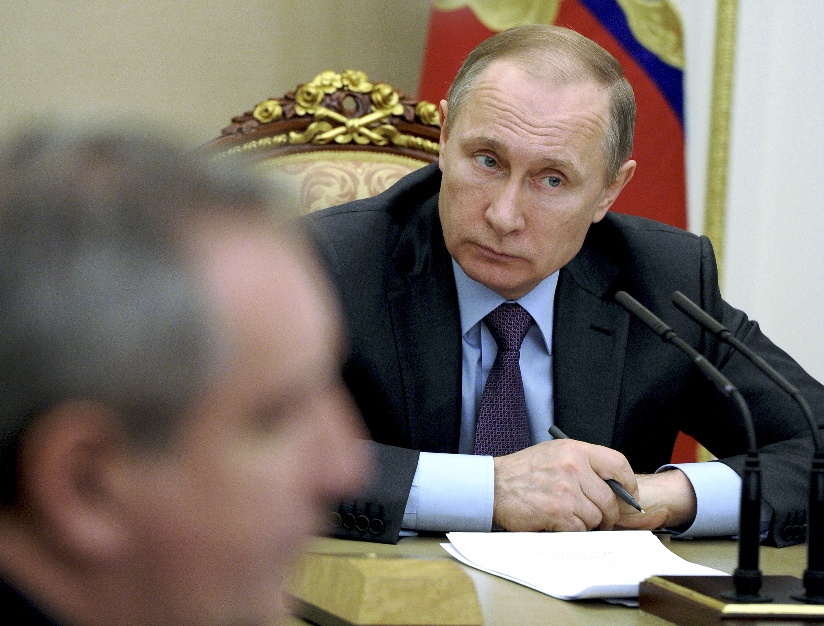 Russian President Vladimir Putin chairs a meeting on counterwork against corruption at the Kremlin in Moscow, Russia, Jan. 26, 2016.