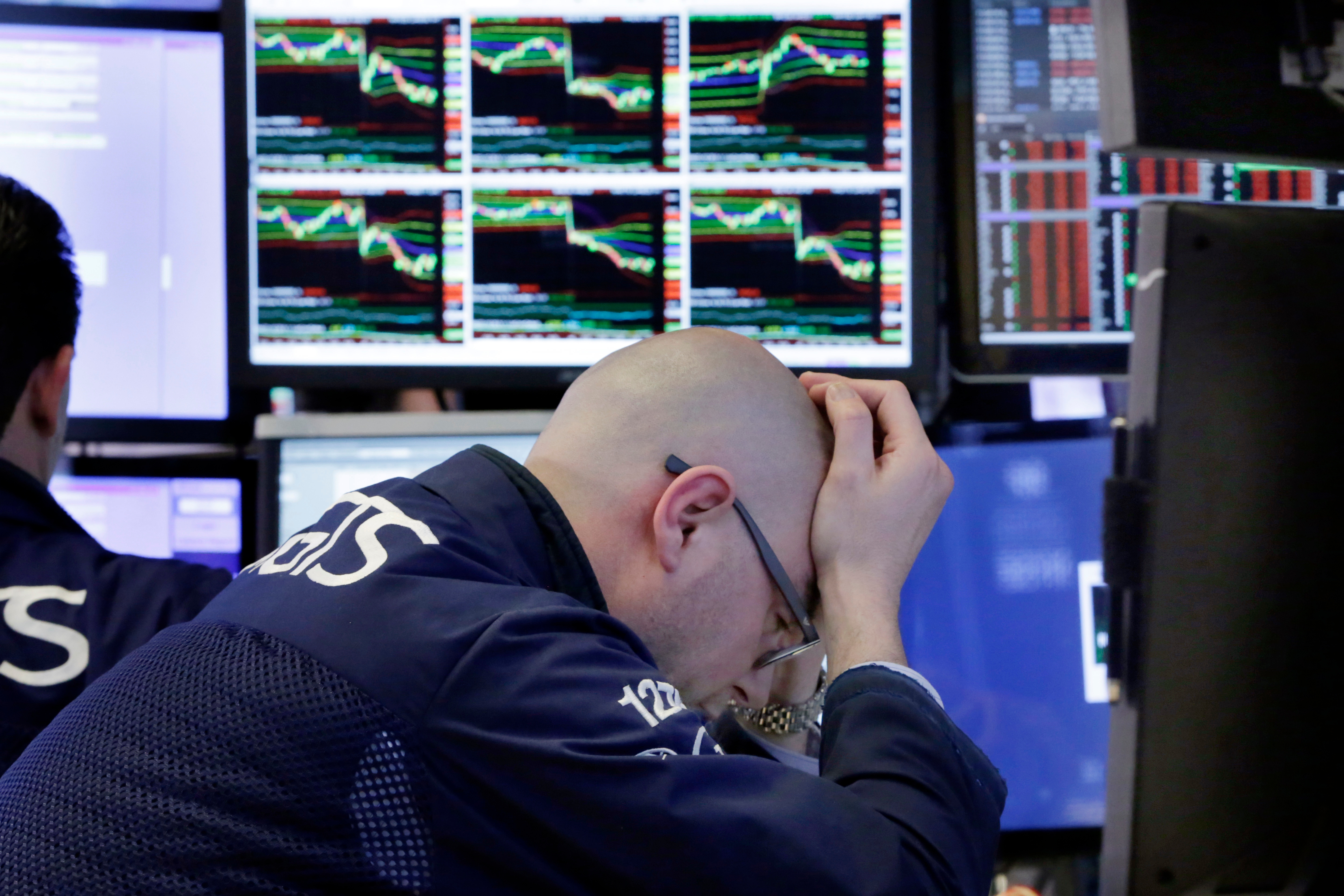 Specialist Mario Picone works at his post on the floor of the New York Stock Exchange, April 6, 2018. Stocks fell again as trade tensions grew between the U.S. and China.
