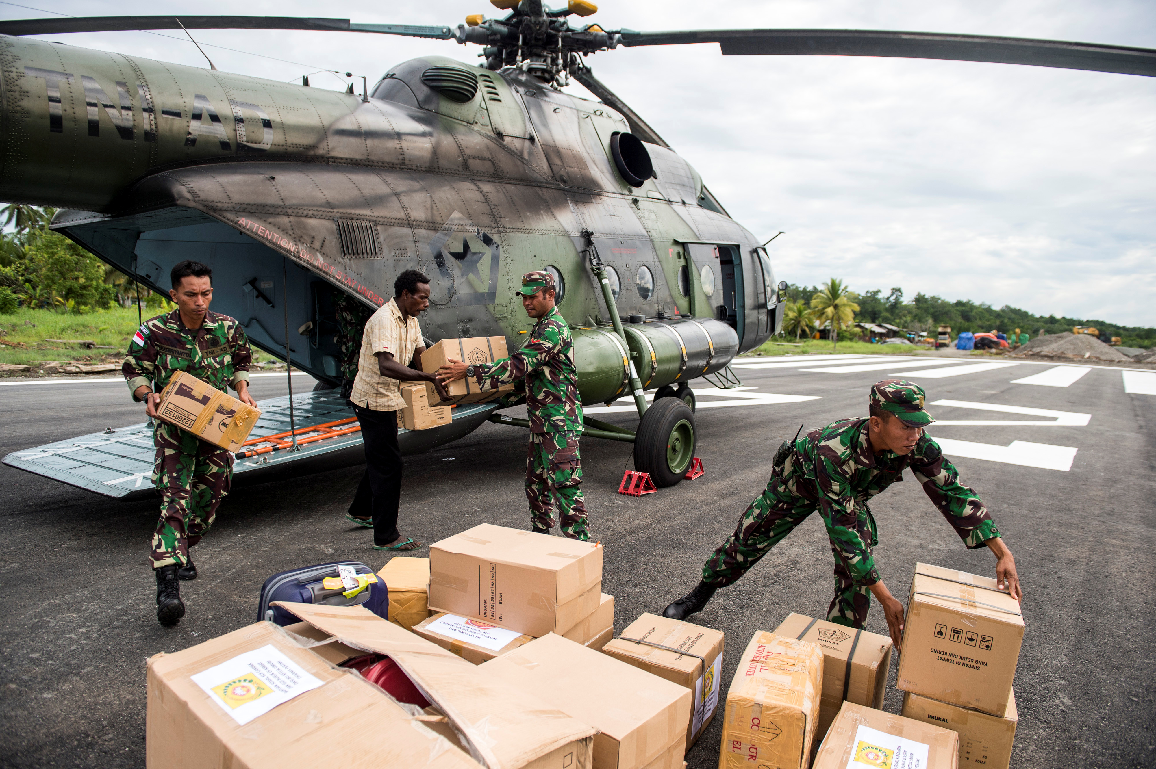 FILE - Indonesian soldiers along with a local resident unload food and medical aid in Ewer, Asmat District, in the remote region of Papua, Indonesia, Jan. 29, 2018 in this photo taken by Antara Foto.