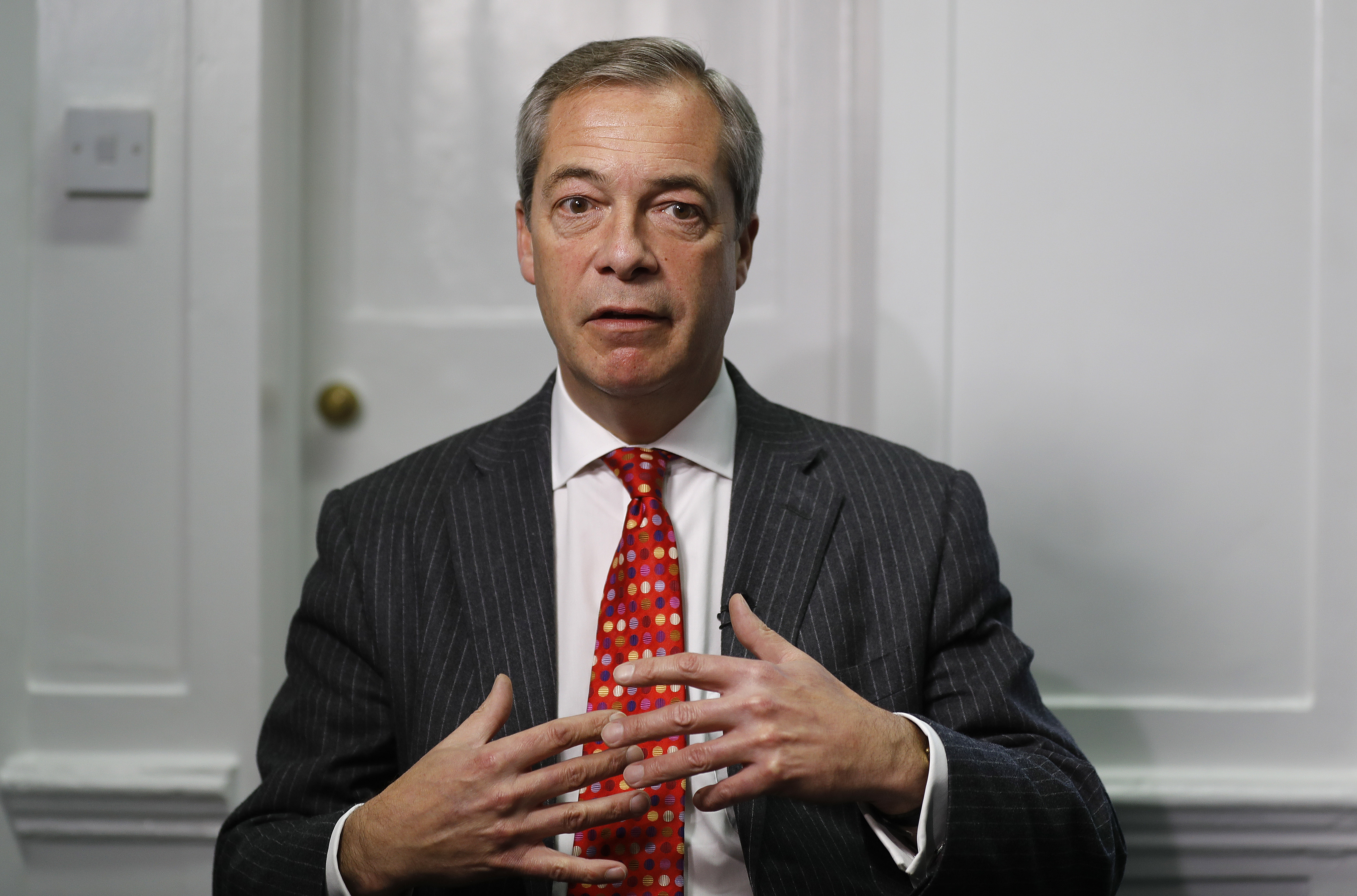 Former UK Independence Party (UKIP) leader Nigel Farage gestures during an interview with The Associated Press in London, Nov. 29, 2016.