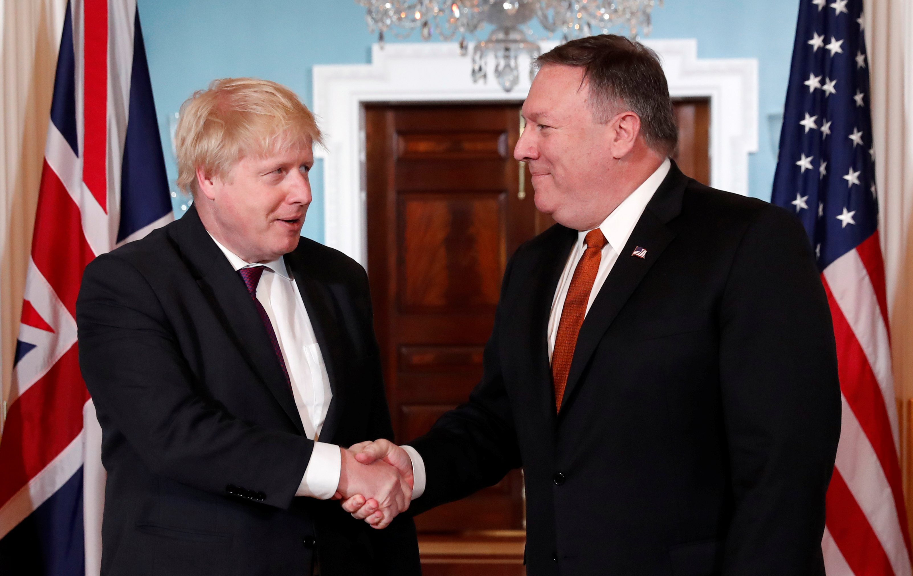 U.S. Secretary of State Mike Pompeo, right, meets with British Foreign Secretary Boris Johnson at the State Department in Washington, May 7, 2018.
